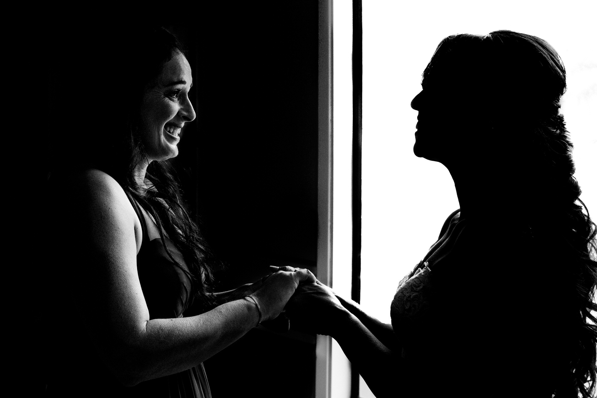 Bride and mother hold hands - photo by Angela Nelson Photography