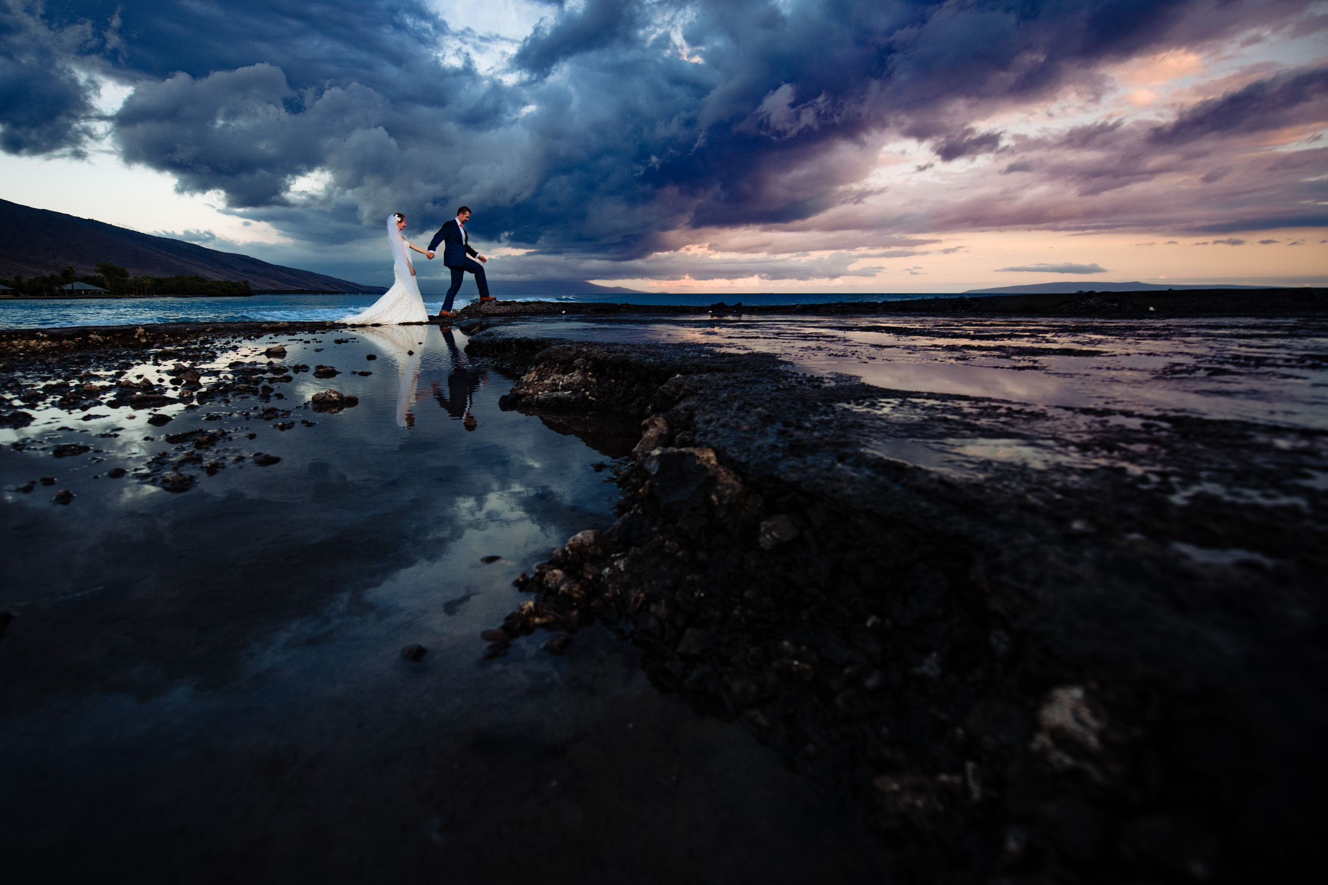 Couple at waters edge - photo by Angela Nelson Photography