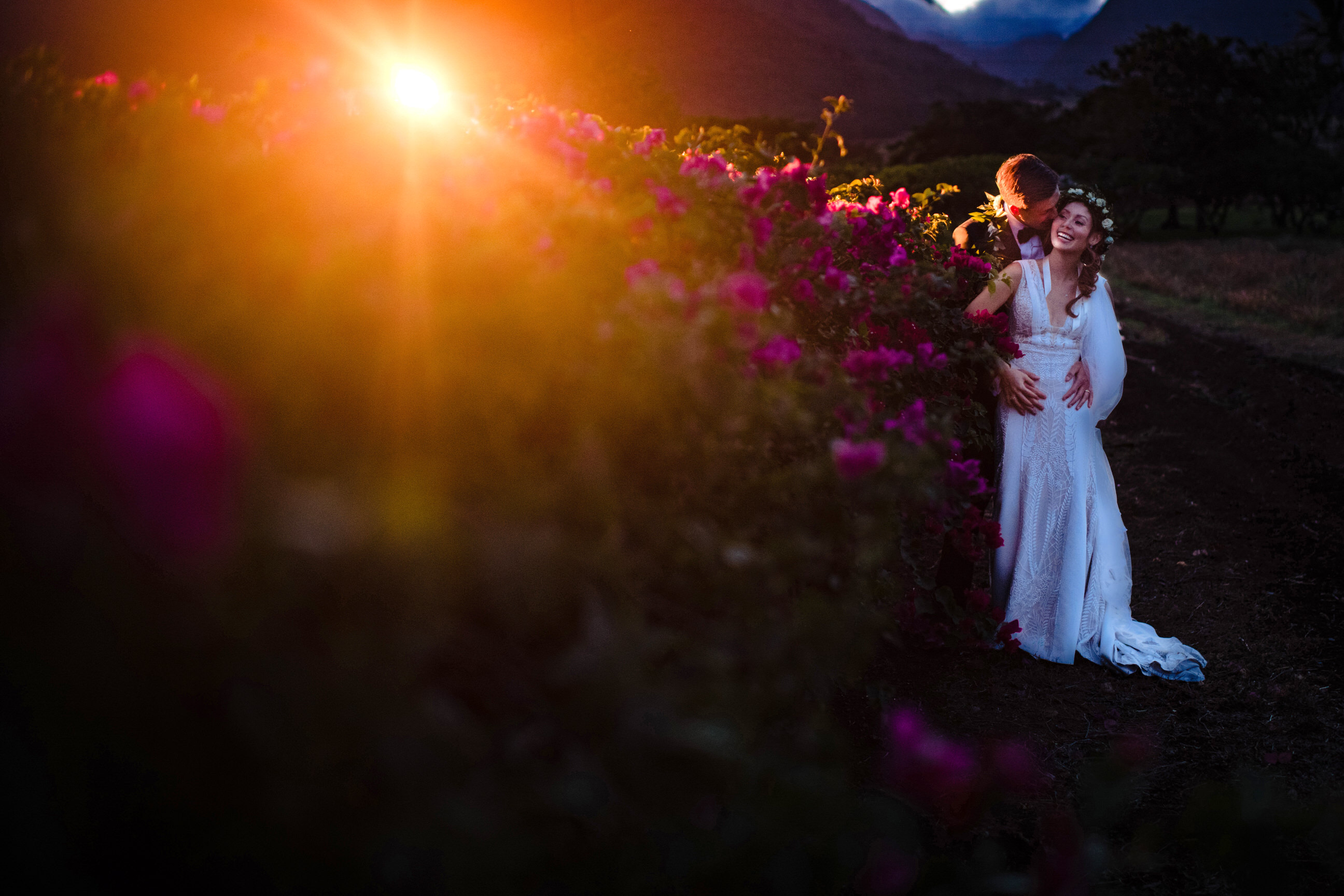 Couple outdoor against late afternoon sun - photo by Angela Nelson Photography