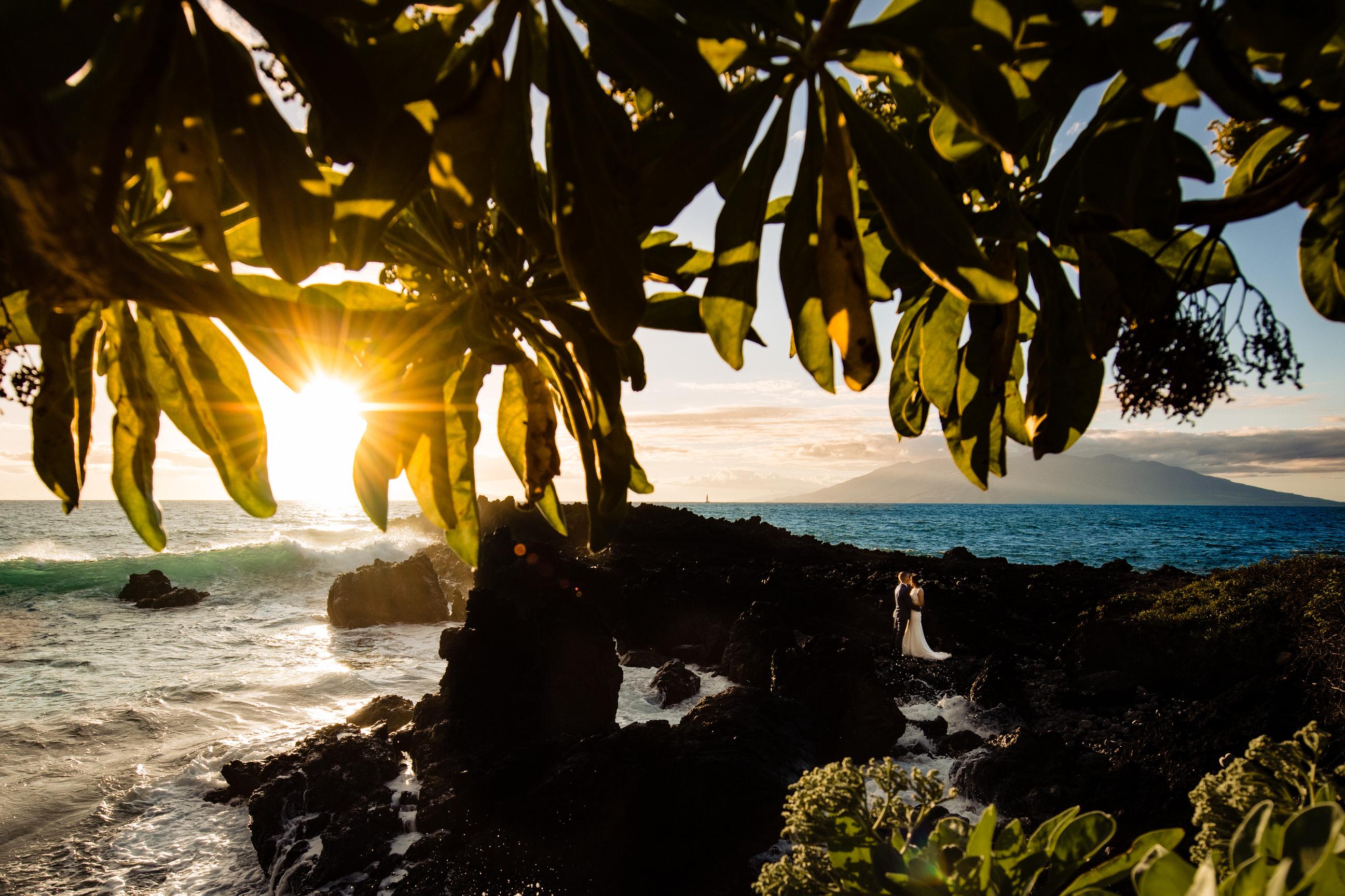 Destination couple portrait against sunset sea - photo by Angela Nelson Photography