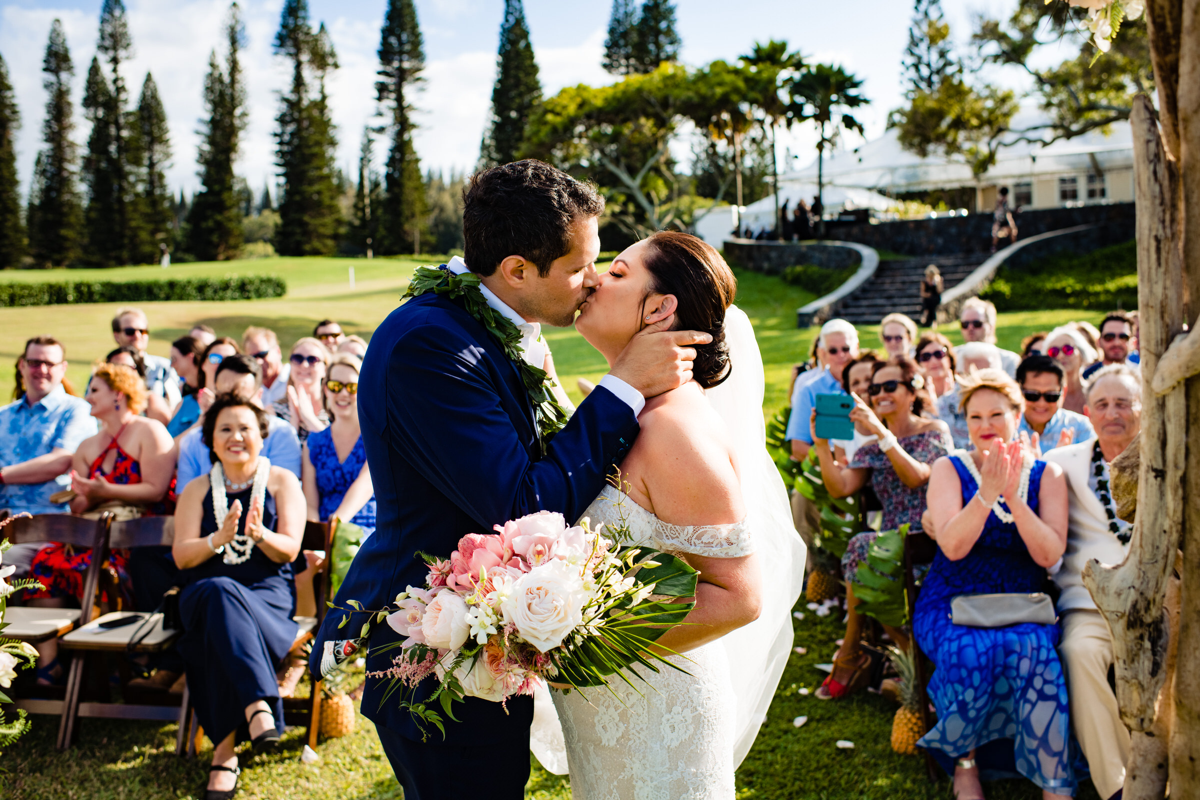 Kissing the bride at outdoor ceremony - photo by Angela Nelson Photography