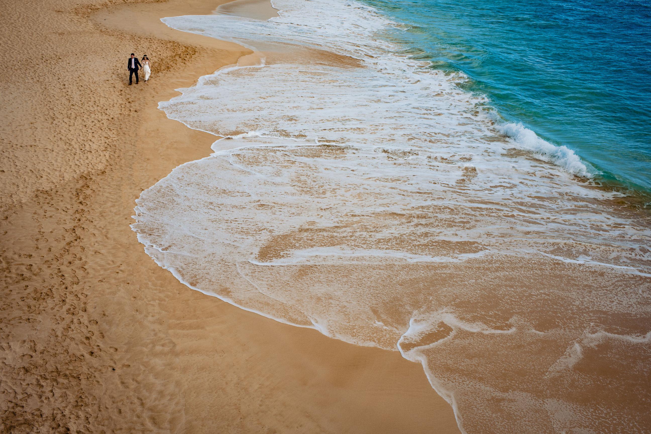 landscape couple portrait at tropical beach - photo by Angela Nelson Photography
