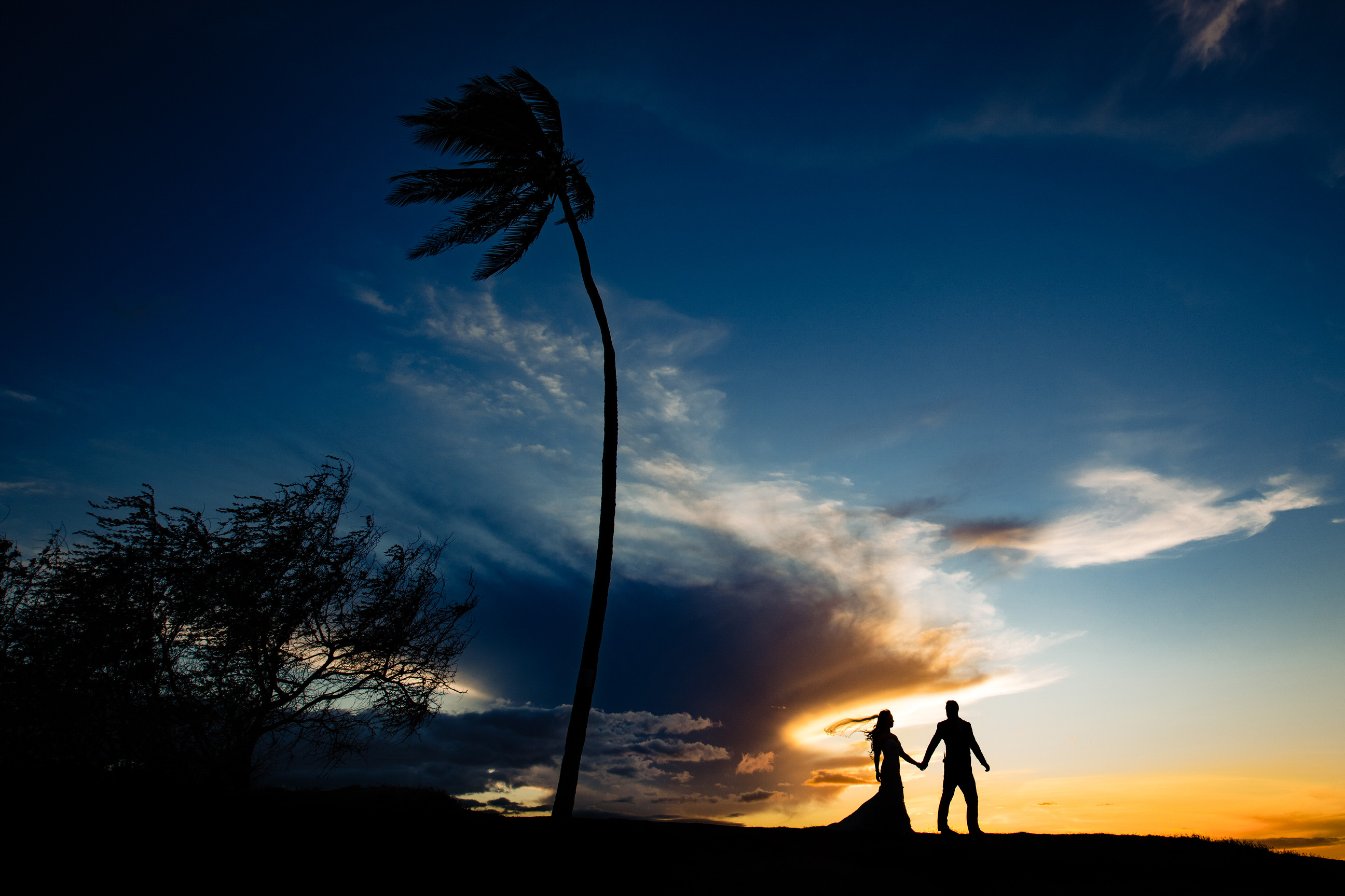 Tropical beach couple silhouette - photo by Angela Nelson Photography