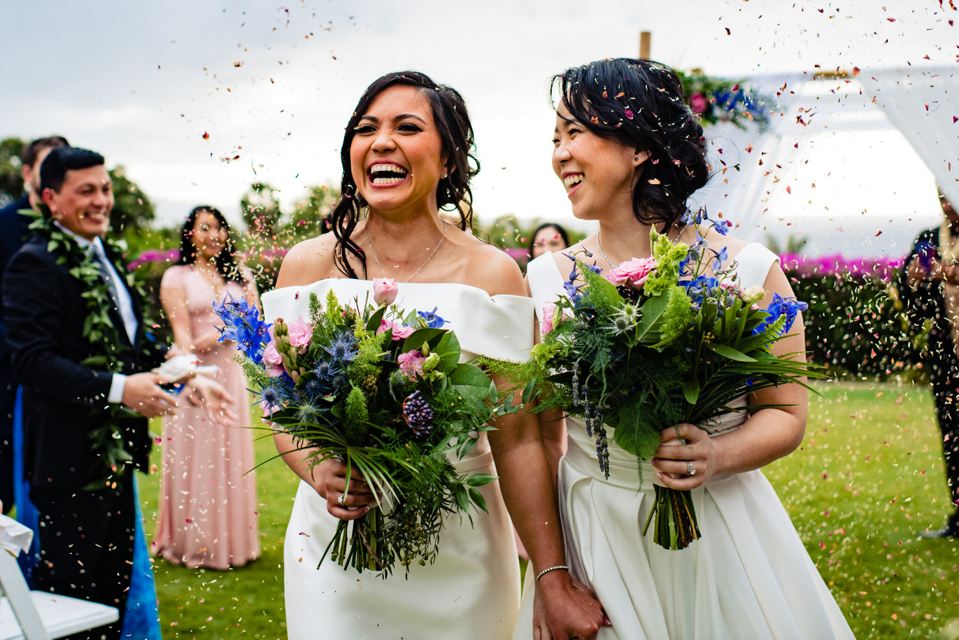Two brides in confetti - photo by Angela Nelson Photography
