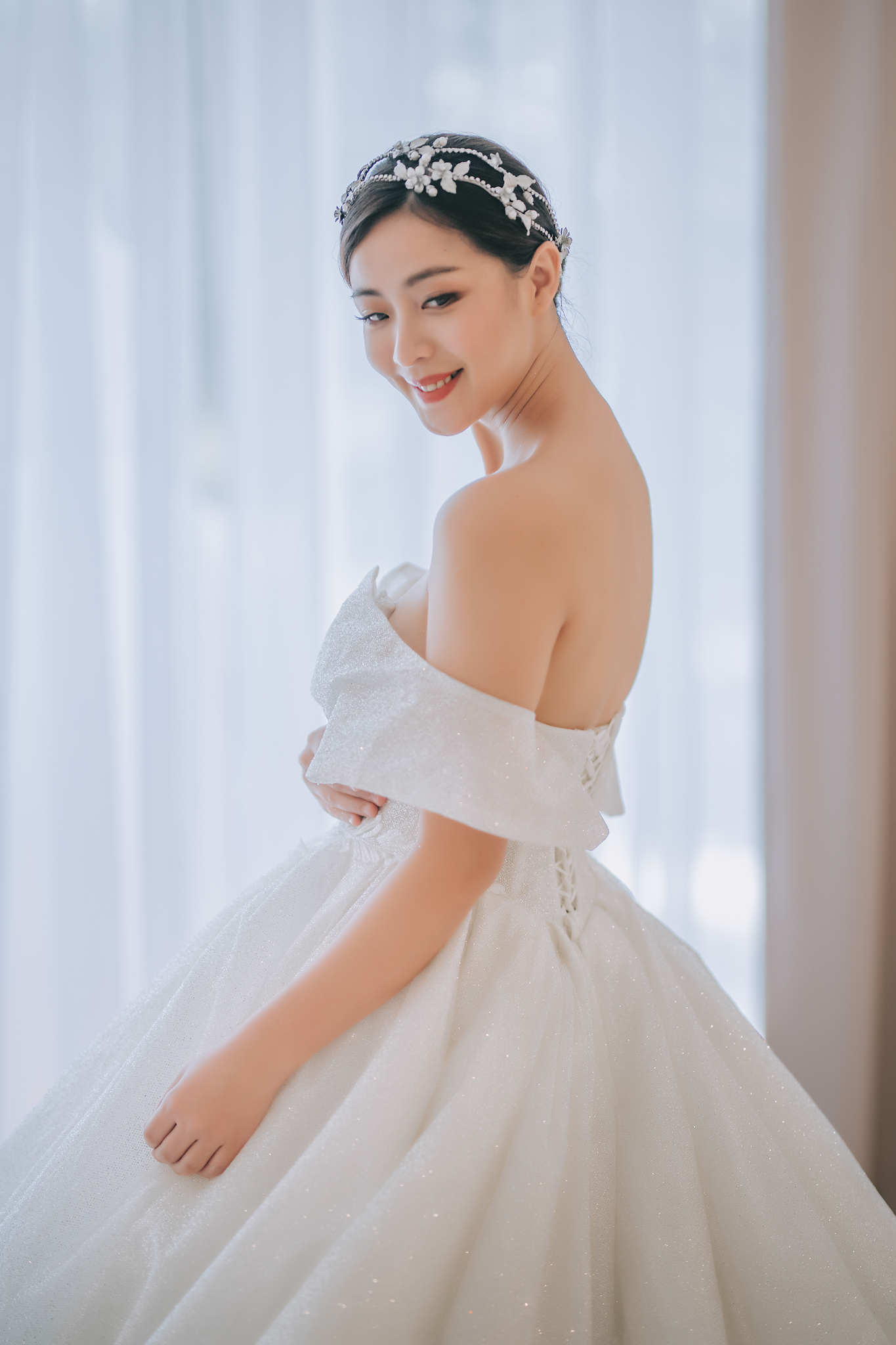 Asian bride with off shoulder ball gown and crystal leaf headpiece - photo by Edwin Tan Photography