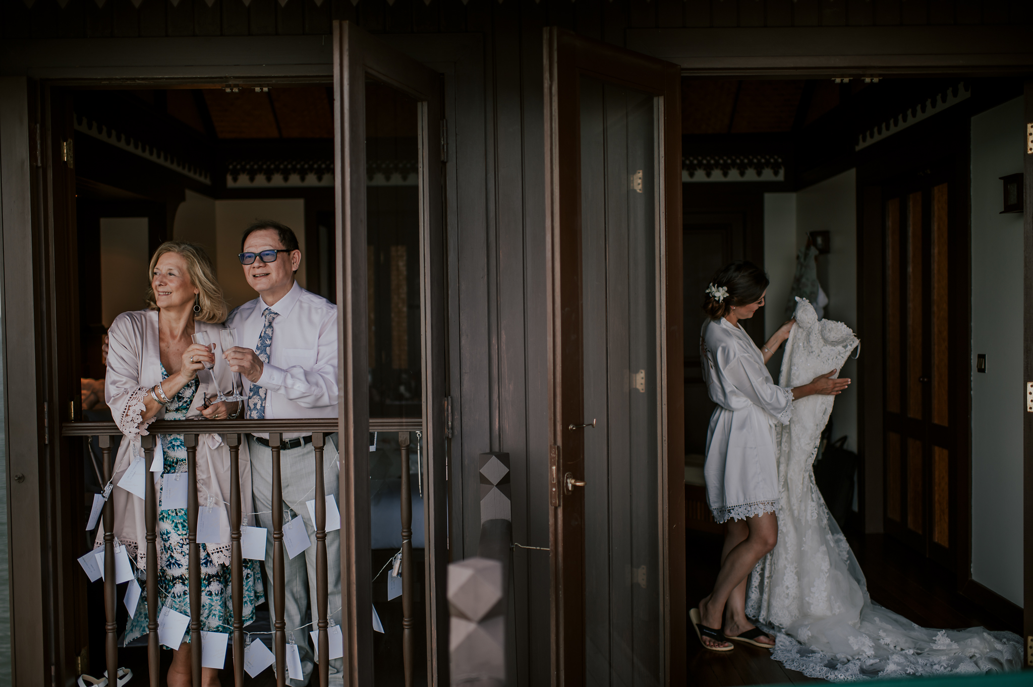 Bride gets ready while parents wait on balcony - photo by Edwin Tan Photography