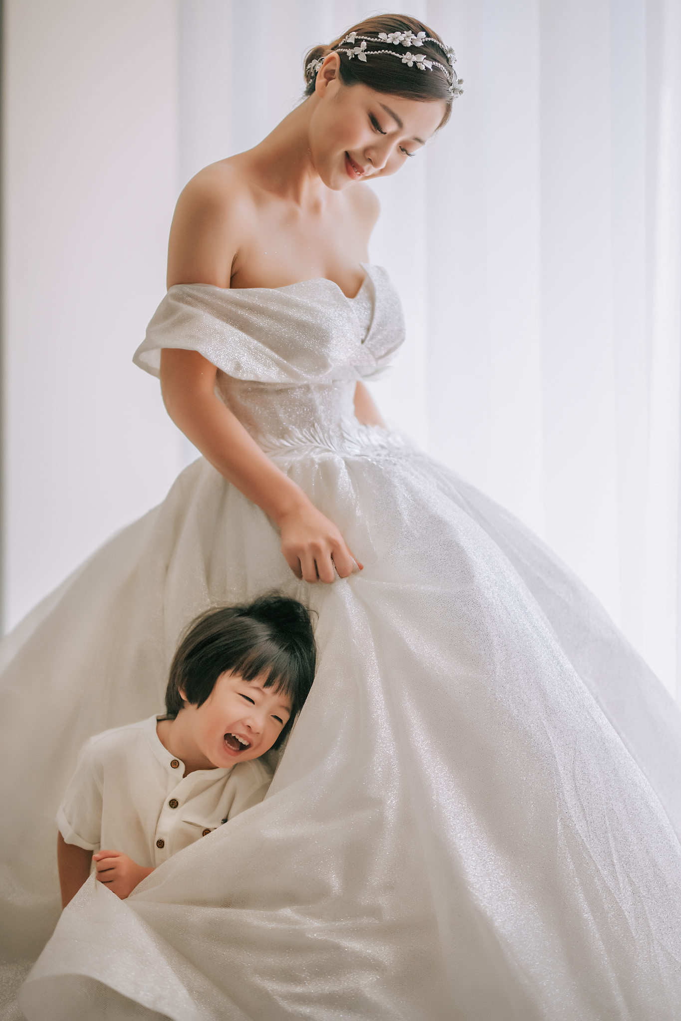 Bride in off shoulder gown and crystal headpiece with little boy - photo by Edwin Tan Photography