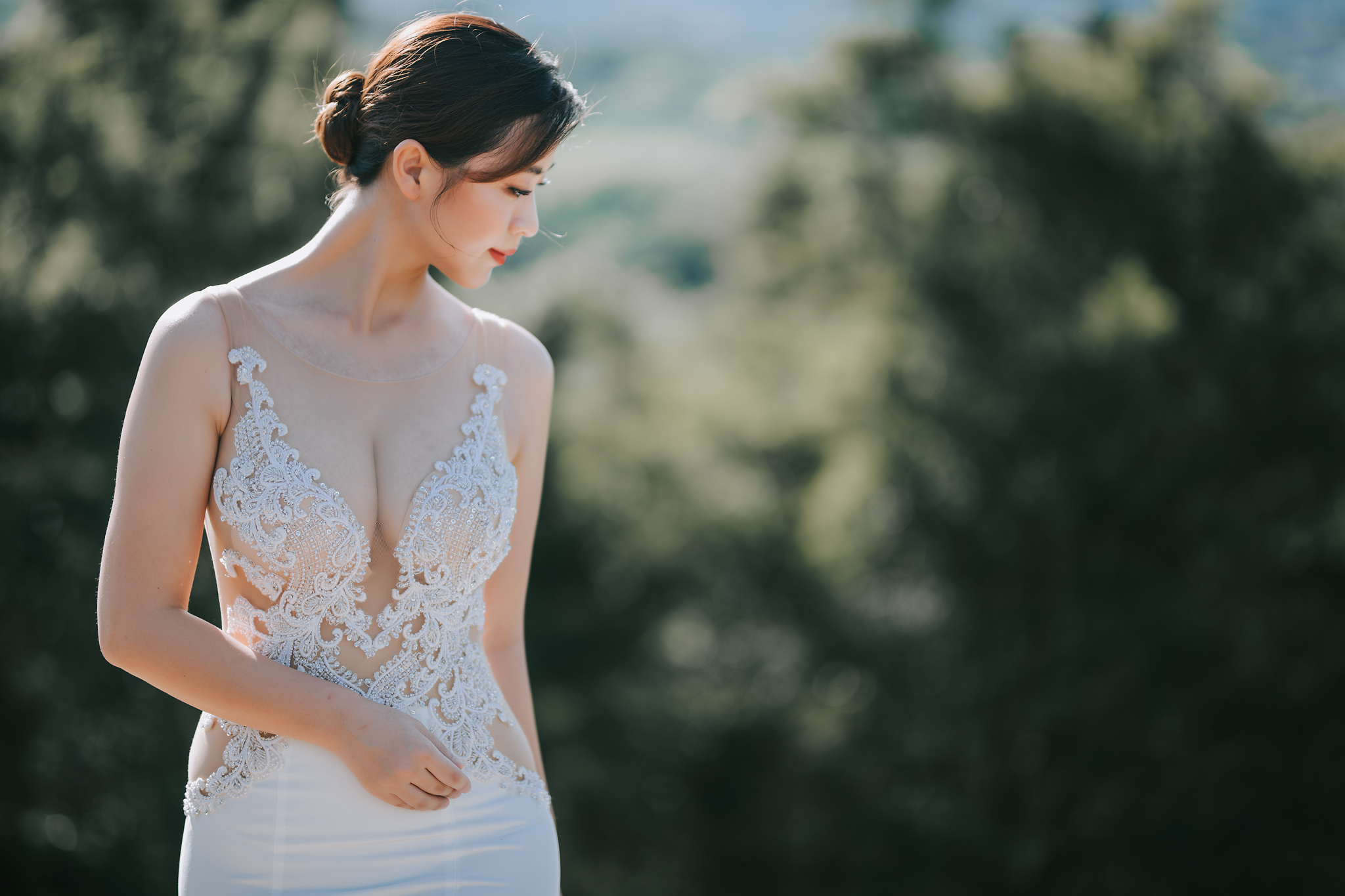 Bride in plunging lace applique dress with see through bodice - photo by Edwin Tan Photography