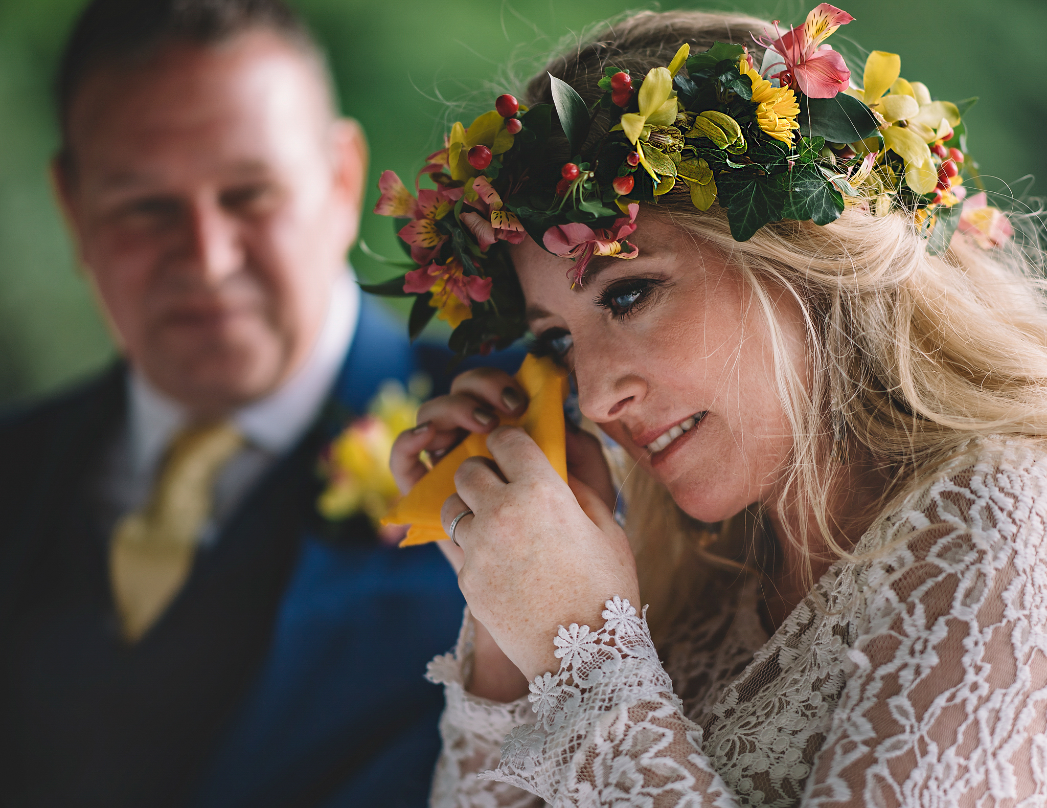 Bride in tropical floral crown wipes her eyes while father looks on- photo by Edwin Tan Photography
