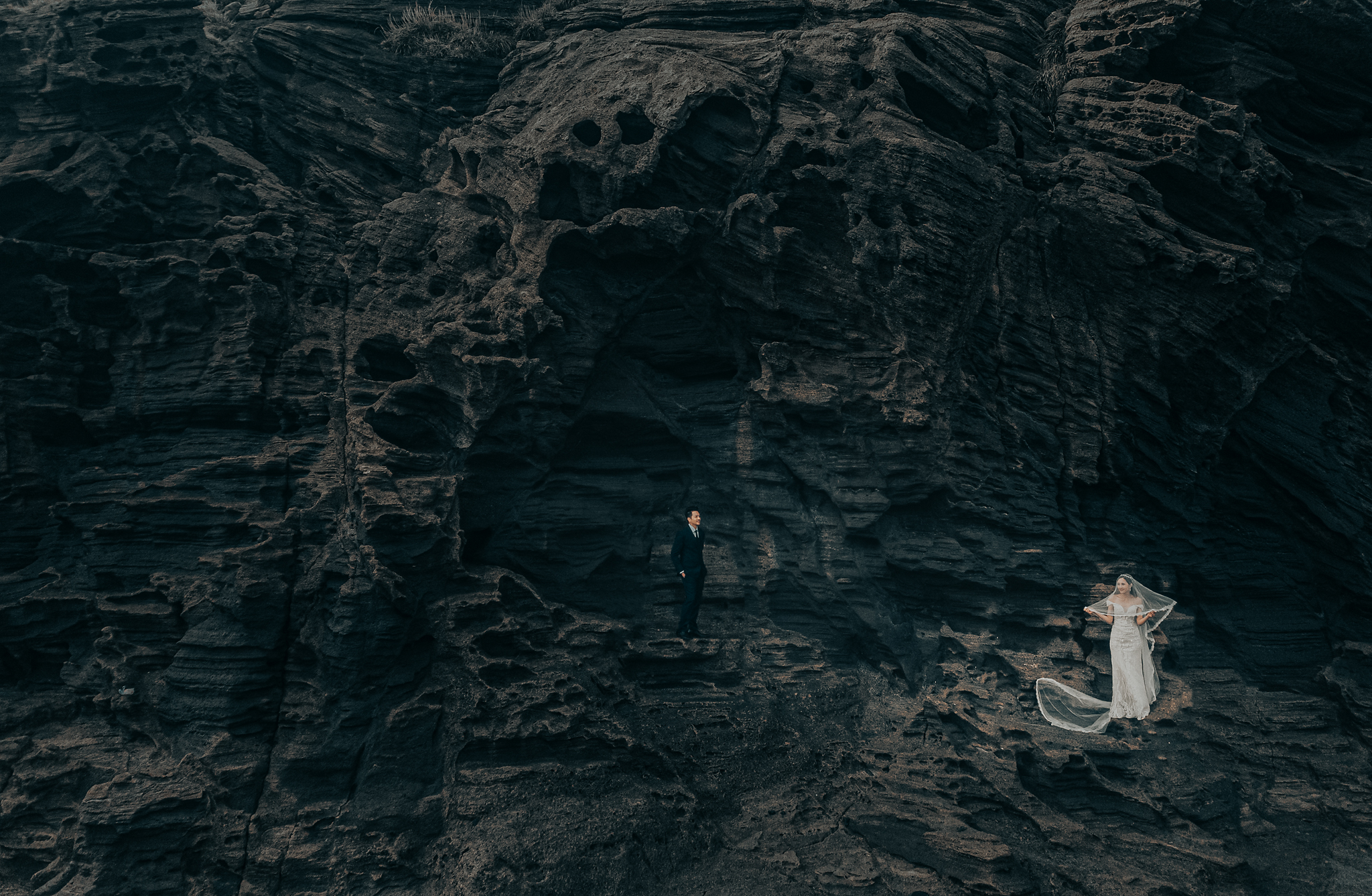 Bride and groom on cliffs - photo by Edwin Tan Photography