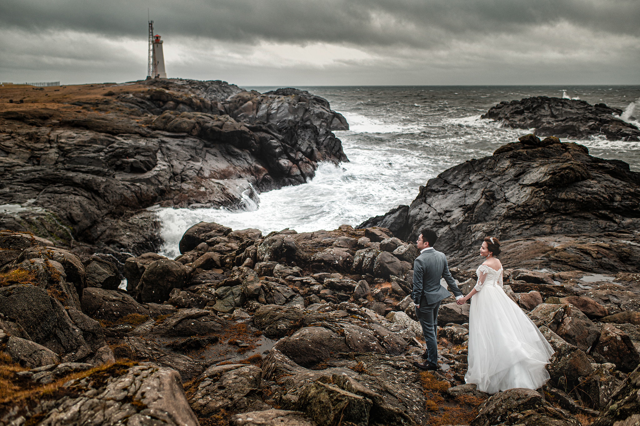 Epic portrait of couple near lighthouse - photo by Edwin Tan Photography