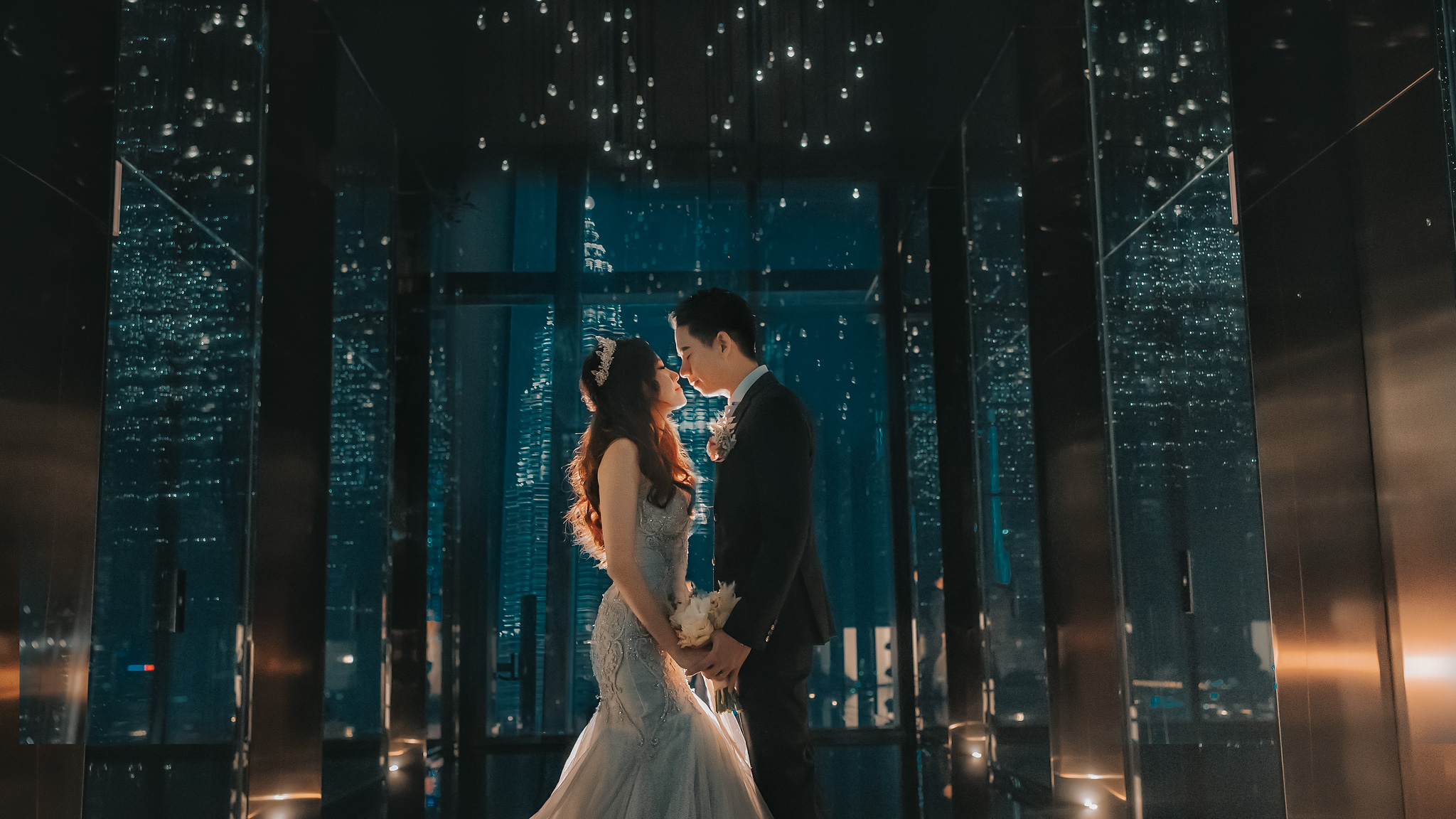 Face to face couple portrait against glass and nighttime city skyline - photo by Edwin Tan Photography