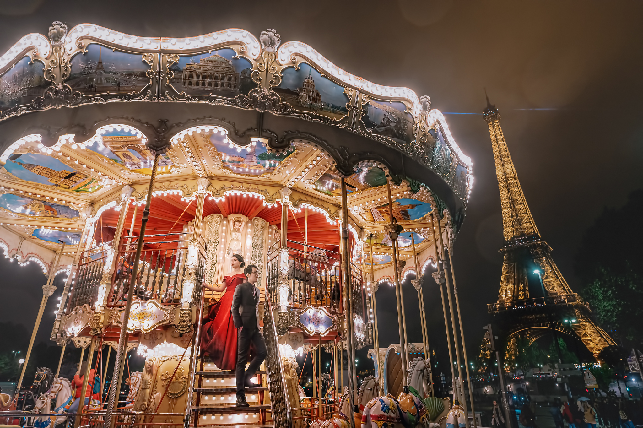 Stylized couple portrait on carousel by eiffel tower- photo by Edwin Tan Photography
