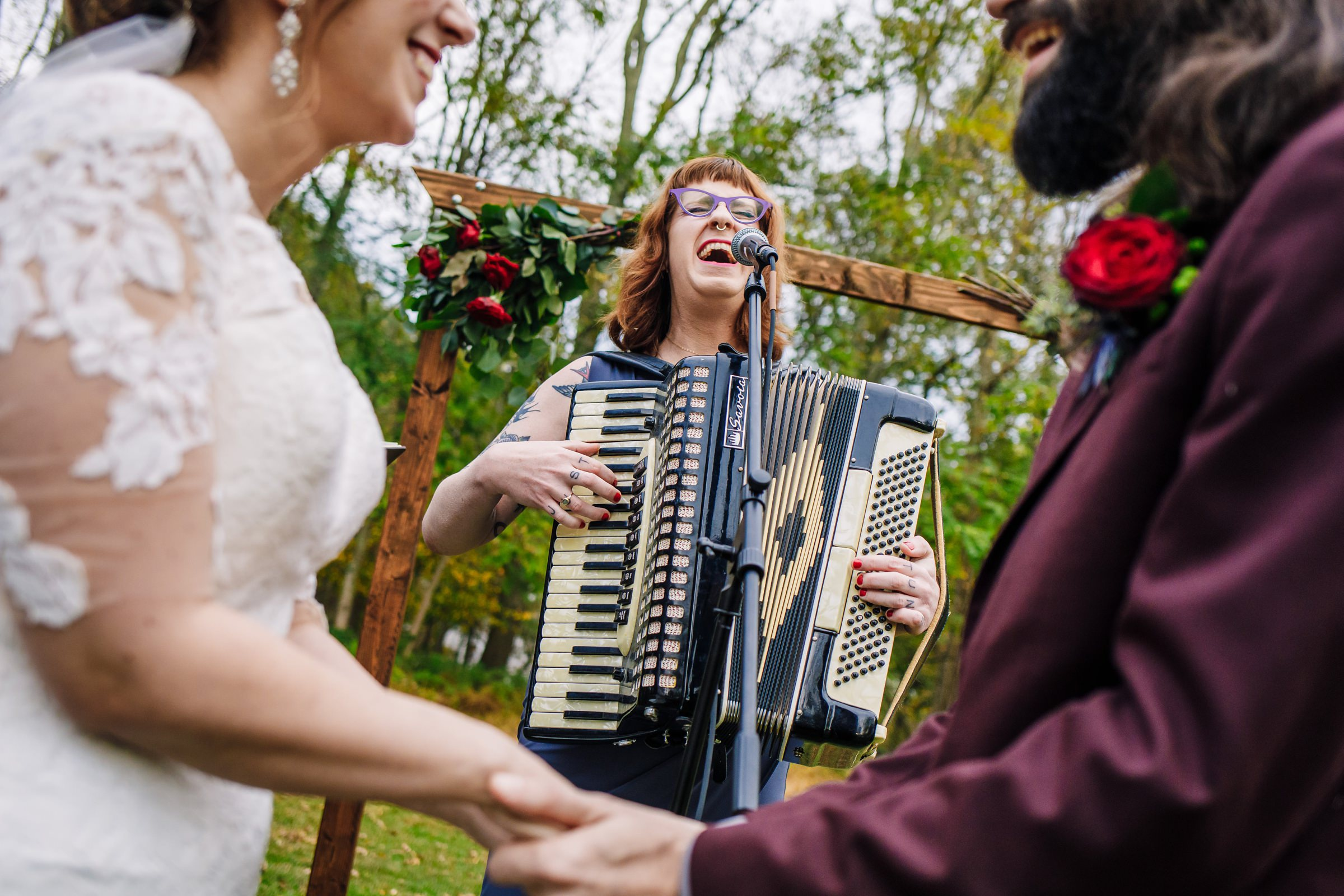 Accordion player sings during ceremony - photo by Photography by Brea