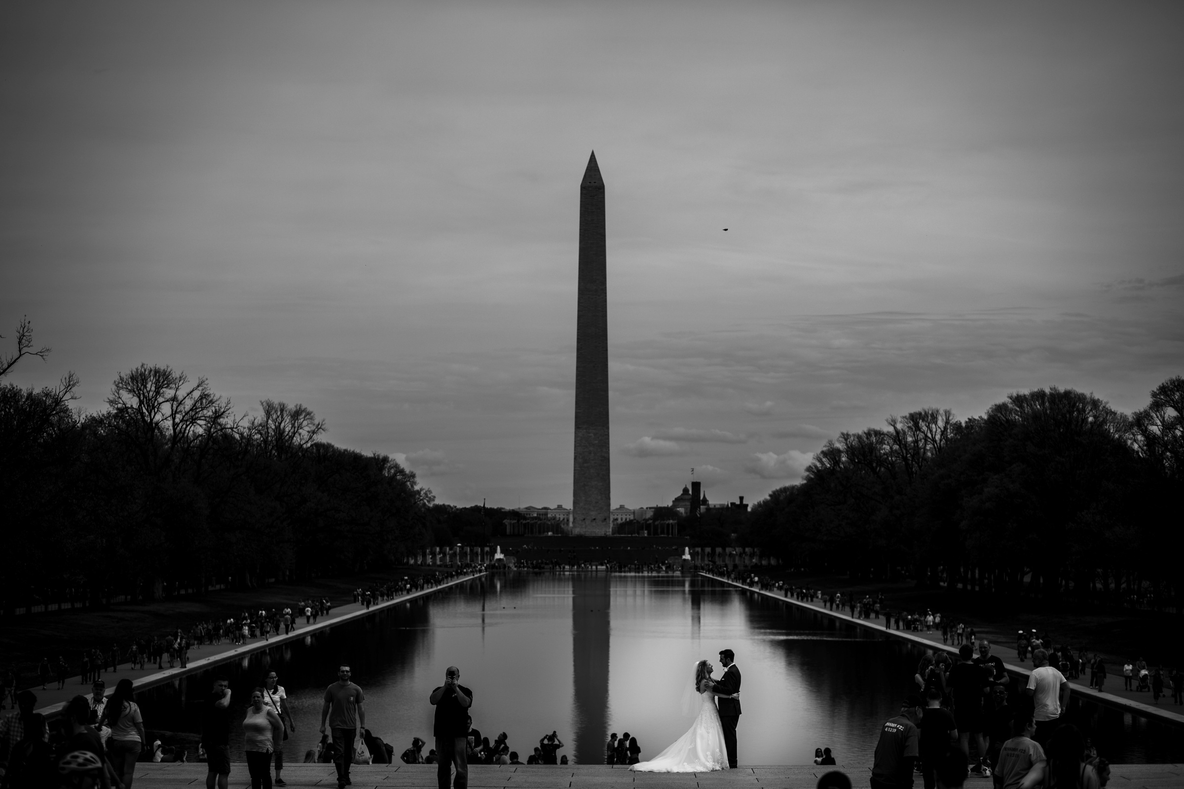 Bride and groom against National Monument - photo by Photography by Brea