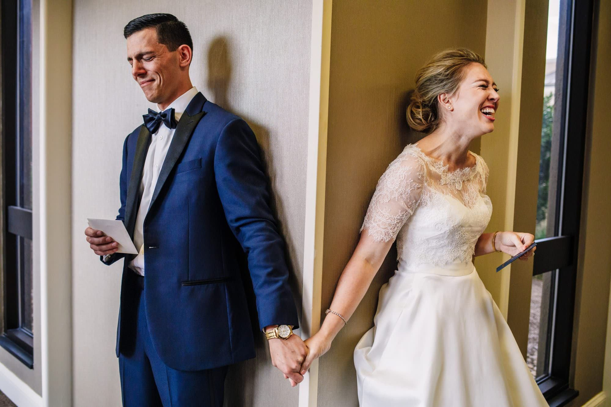 Bride and groom holding hands during blind first look - photo by Photography by Brea