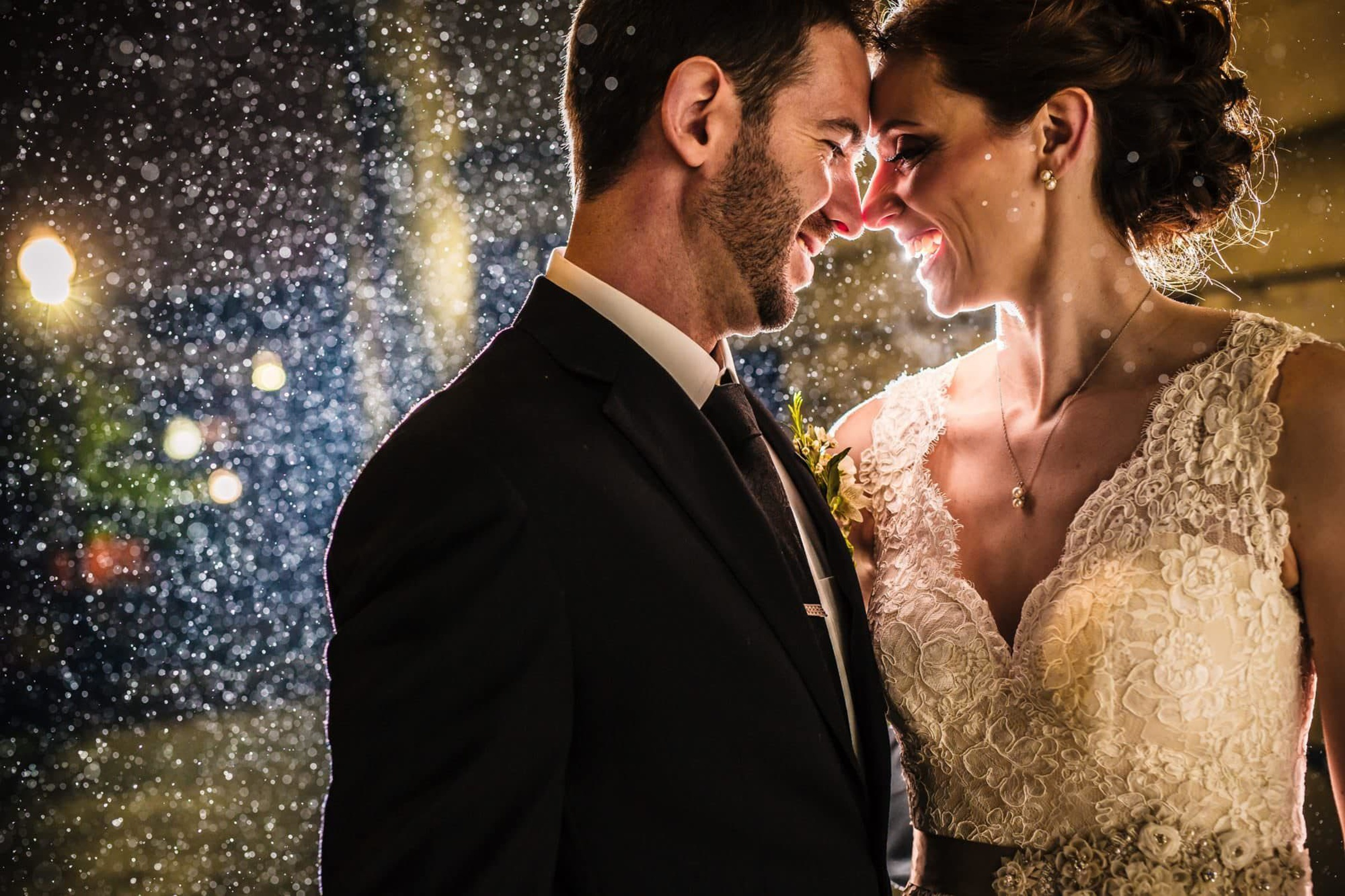 Bride and groom in the rain - photo by Photography by Brea
