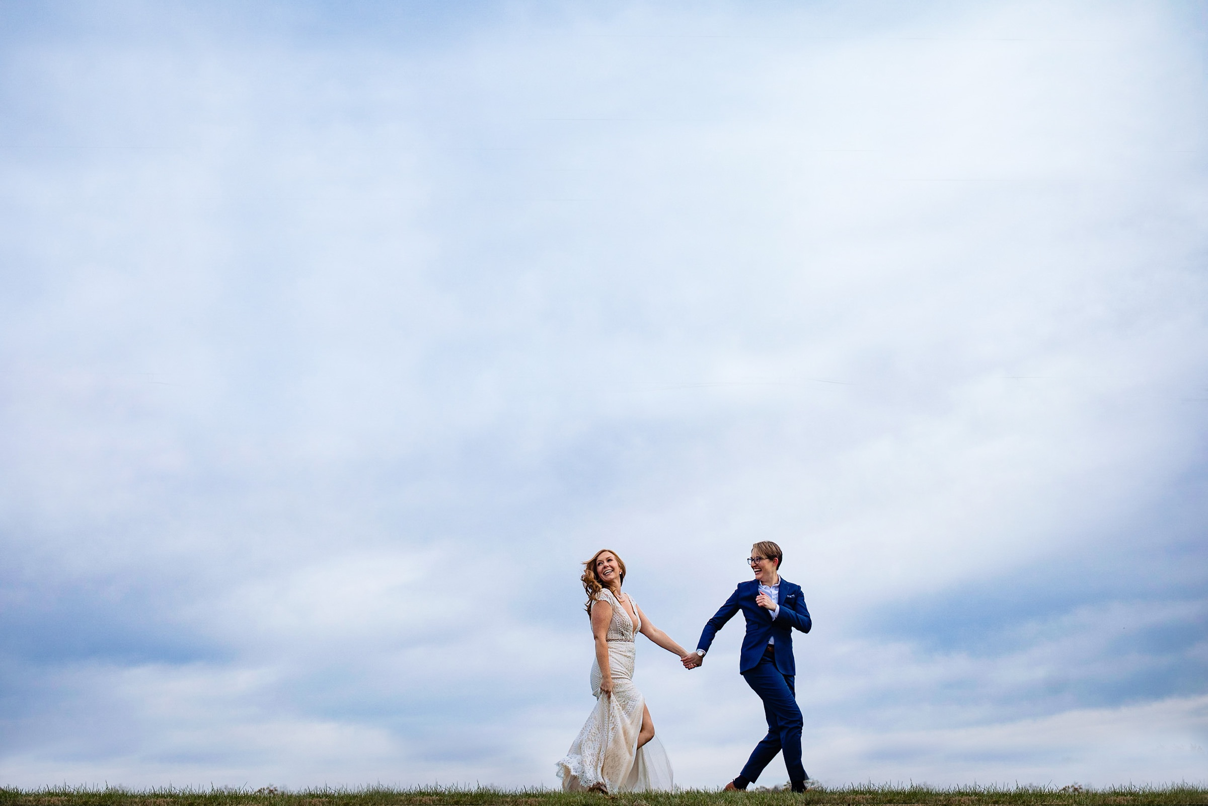 Brides against blue skies - photo by Photography by Brea