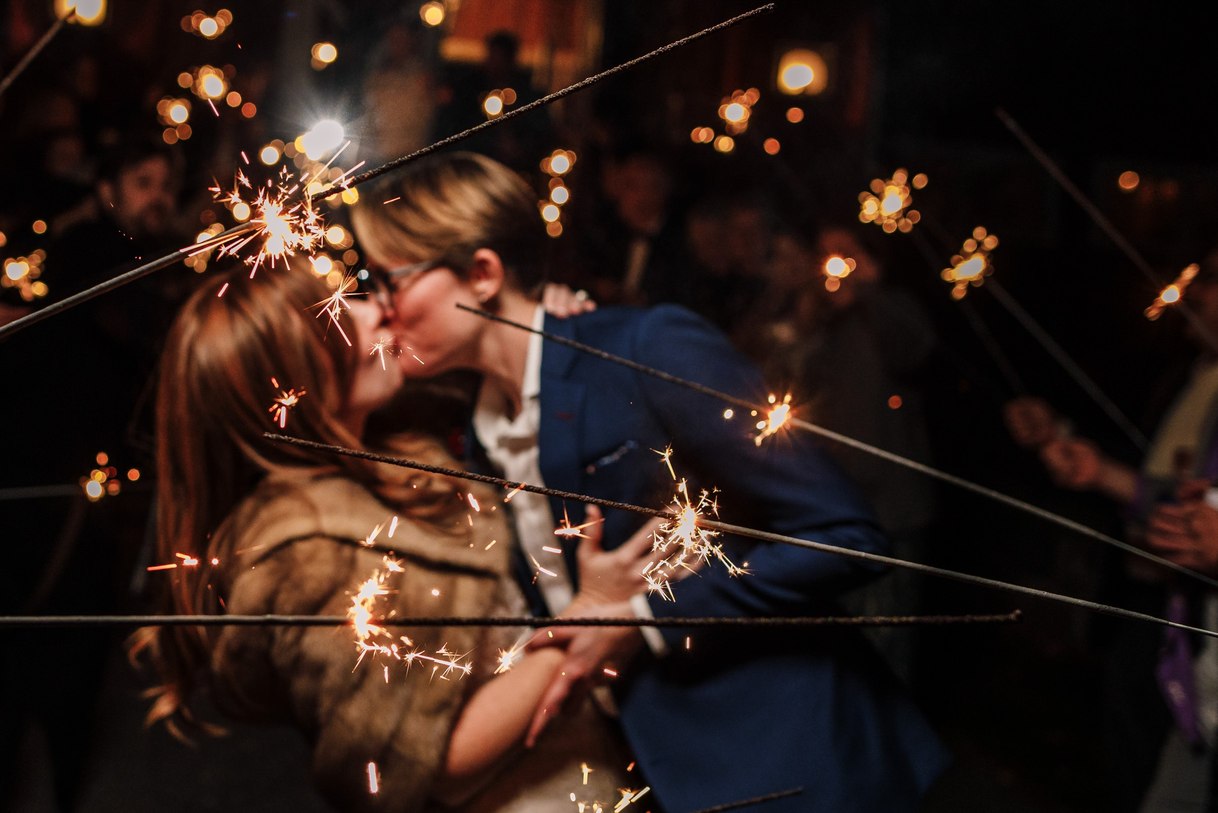 Couple during sparkler exit - photo by Photography by Brea