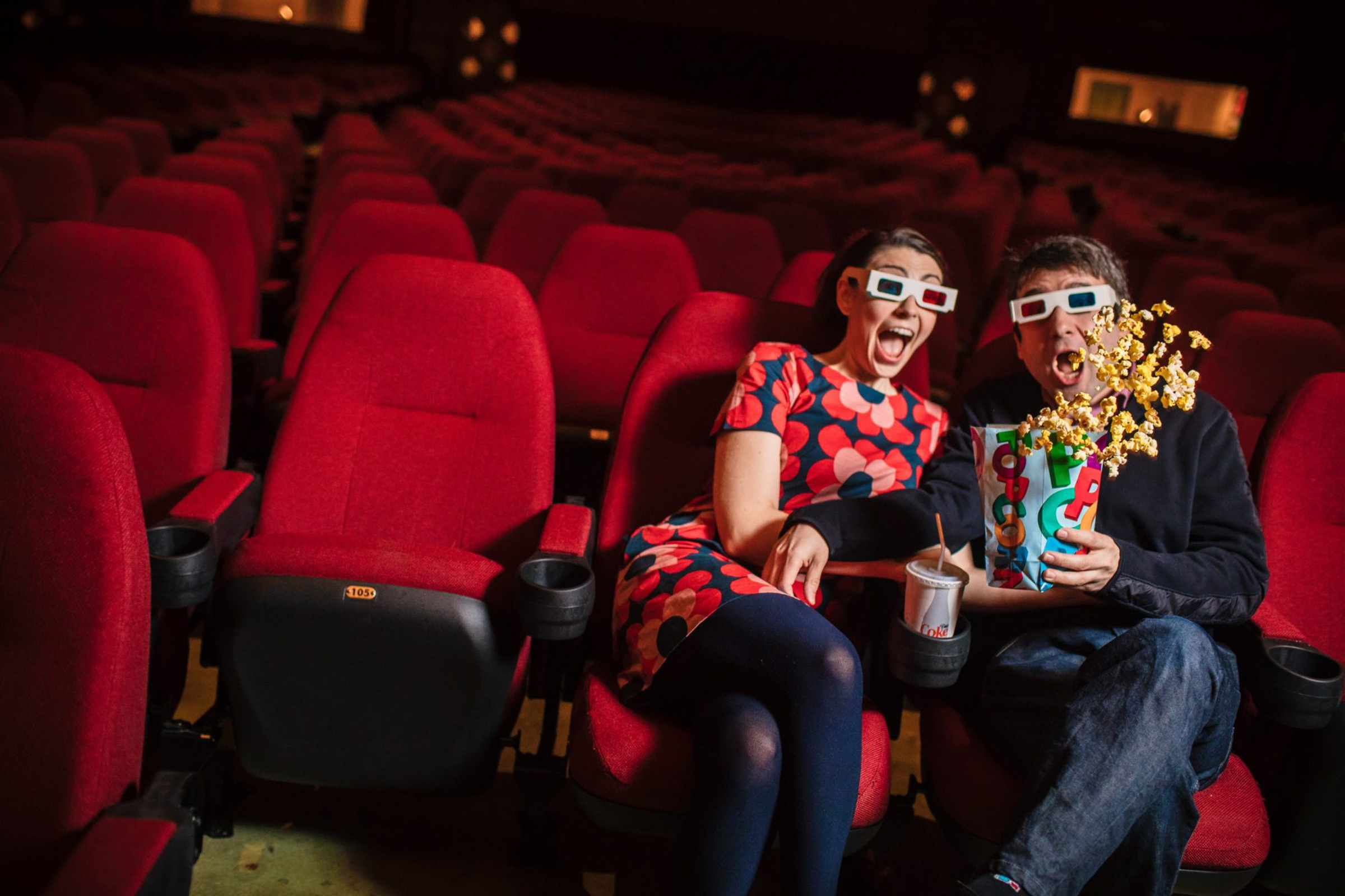 Couple with 3D glasses at cinema with spilling popcorn - photo by Photography by Brea