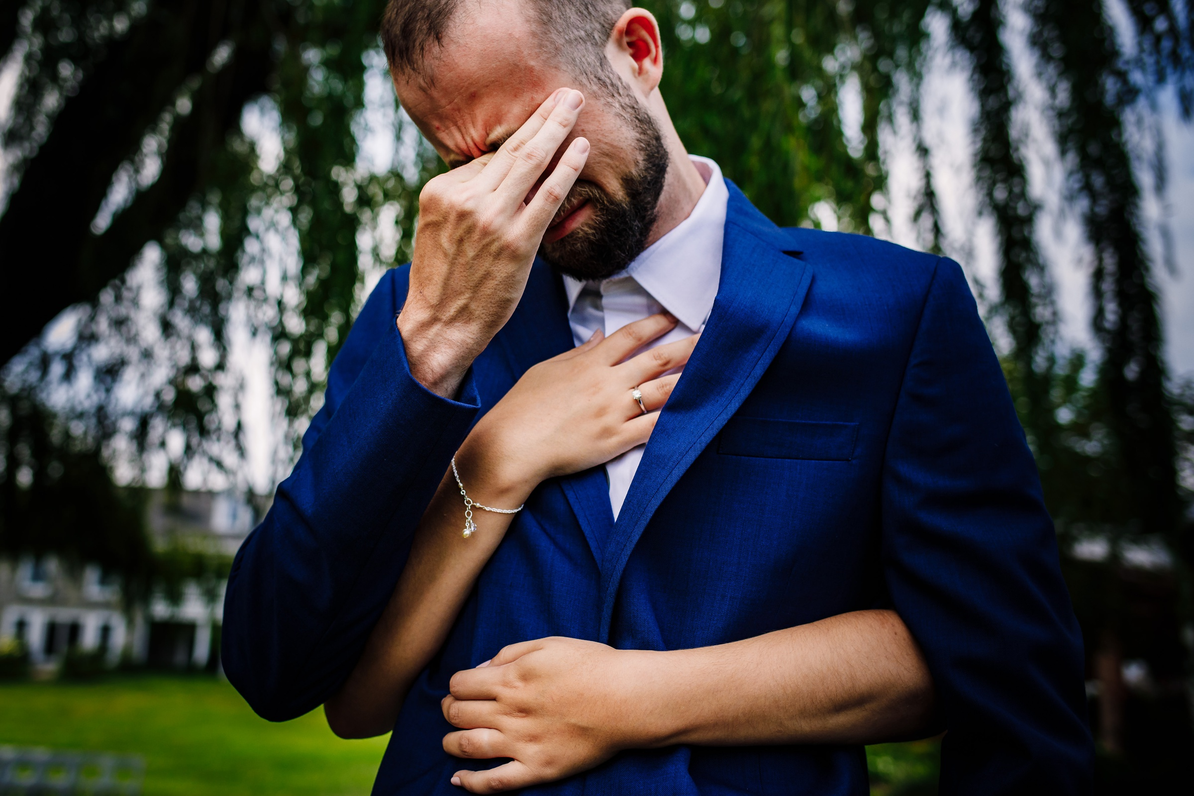 Groom gets emotional during first look - photo by Photography by Brea