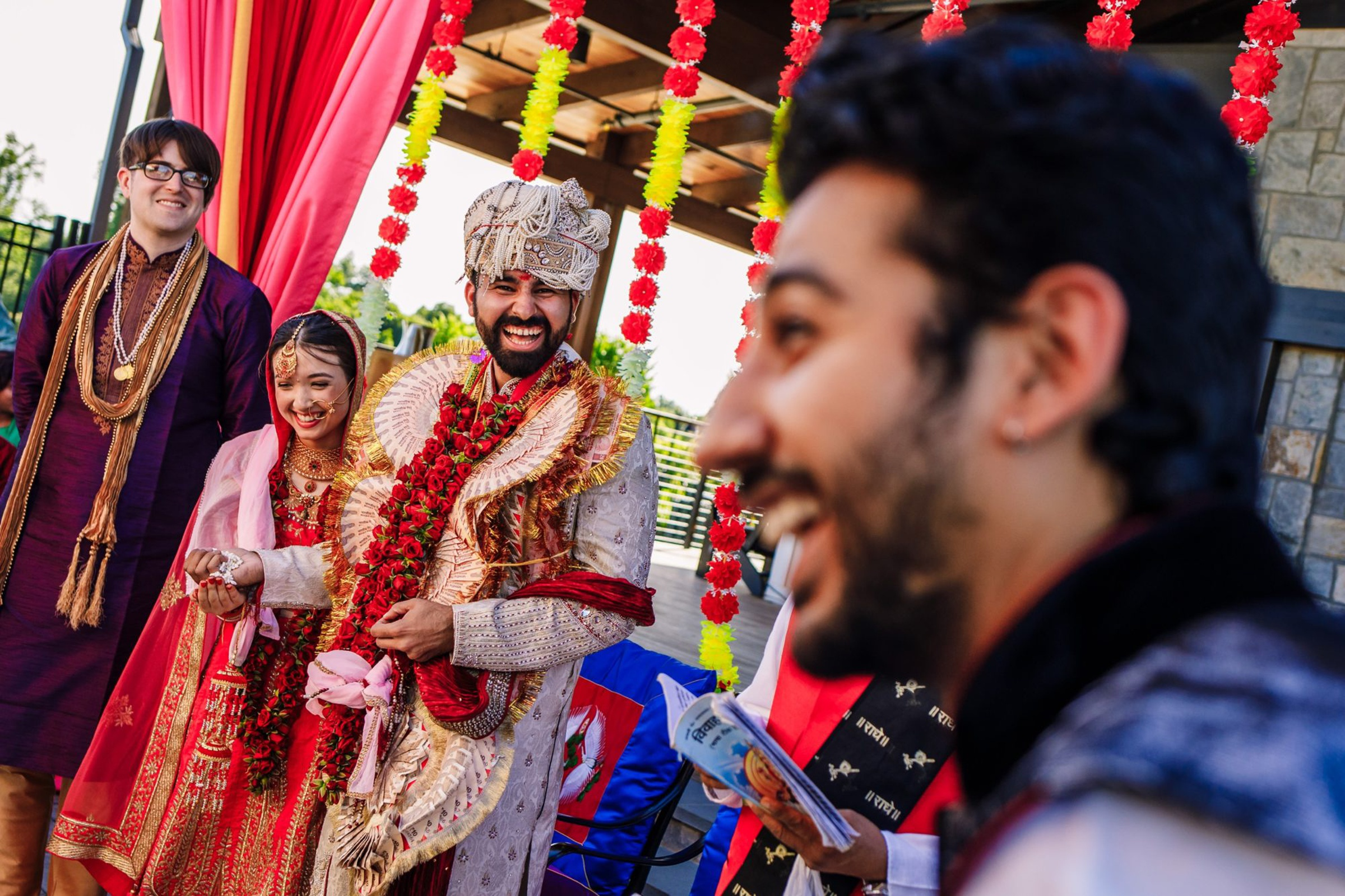 Indian bride and groom laughing - photo by Photography by Brea