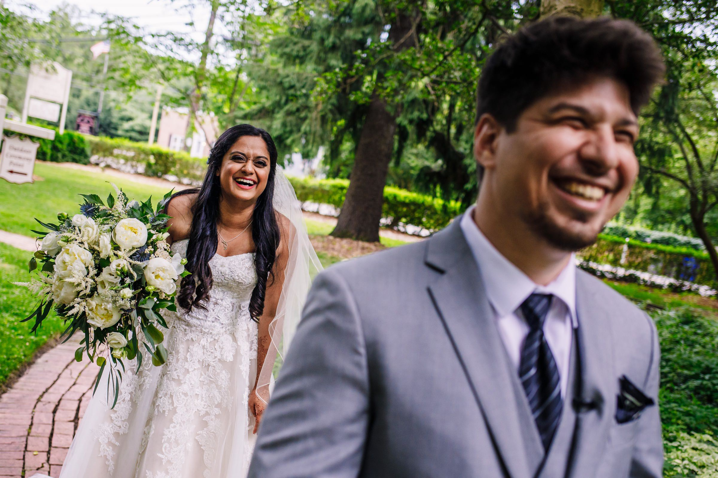 Laughing groom and excited bride during first look - photo by Photography by Brea
