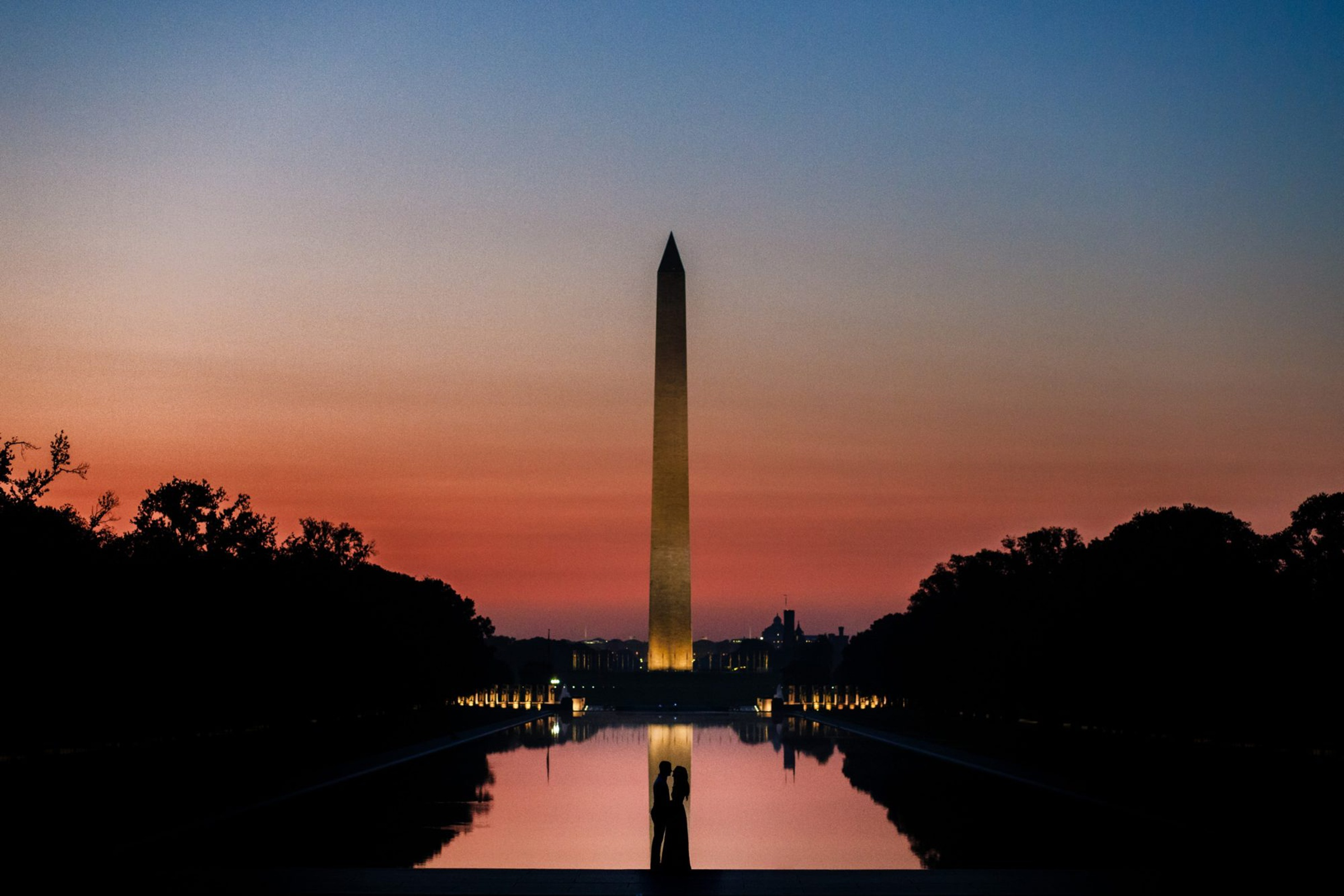 Silhoutte of couple at National Monument - photo by Photography by Brea