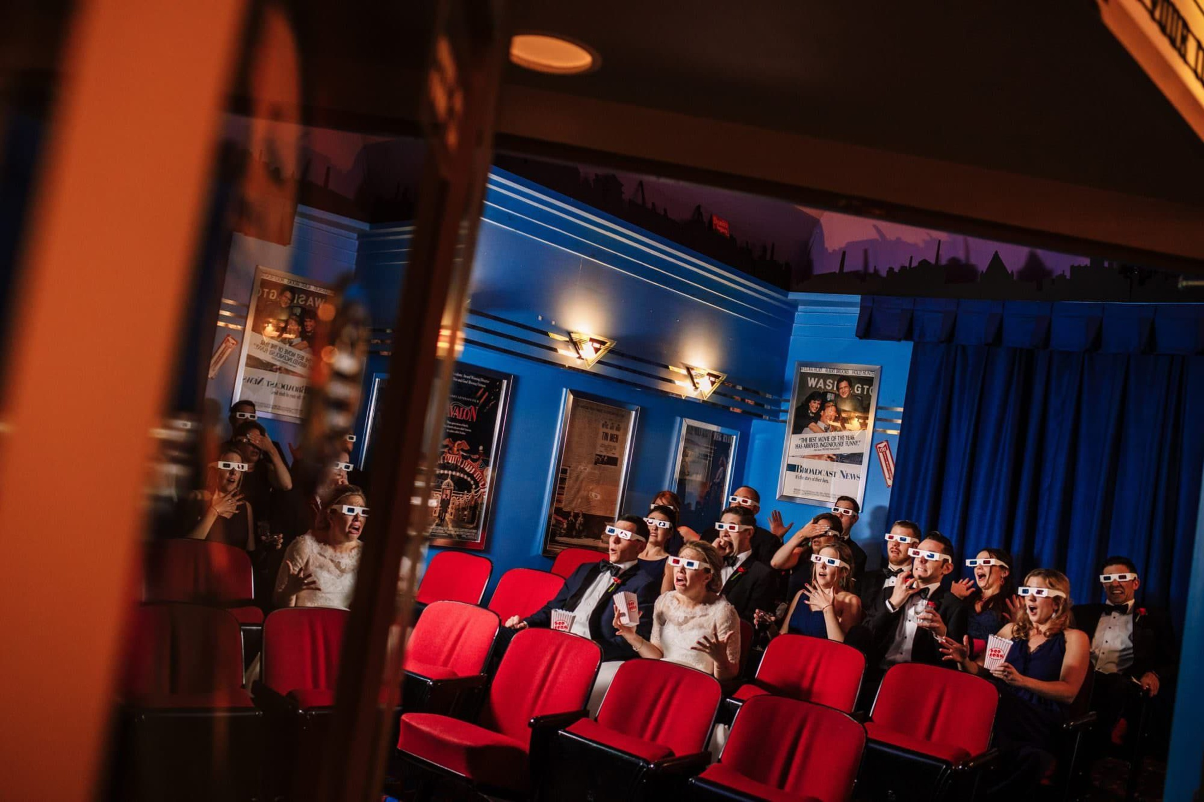 Wedding party in 3D glasses at theater - photo by Photography by Brea