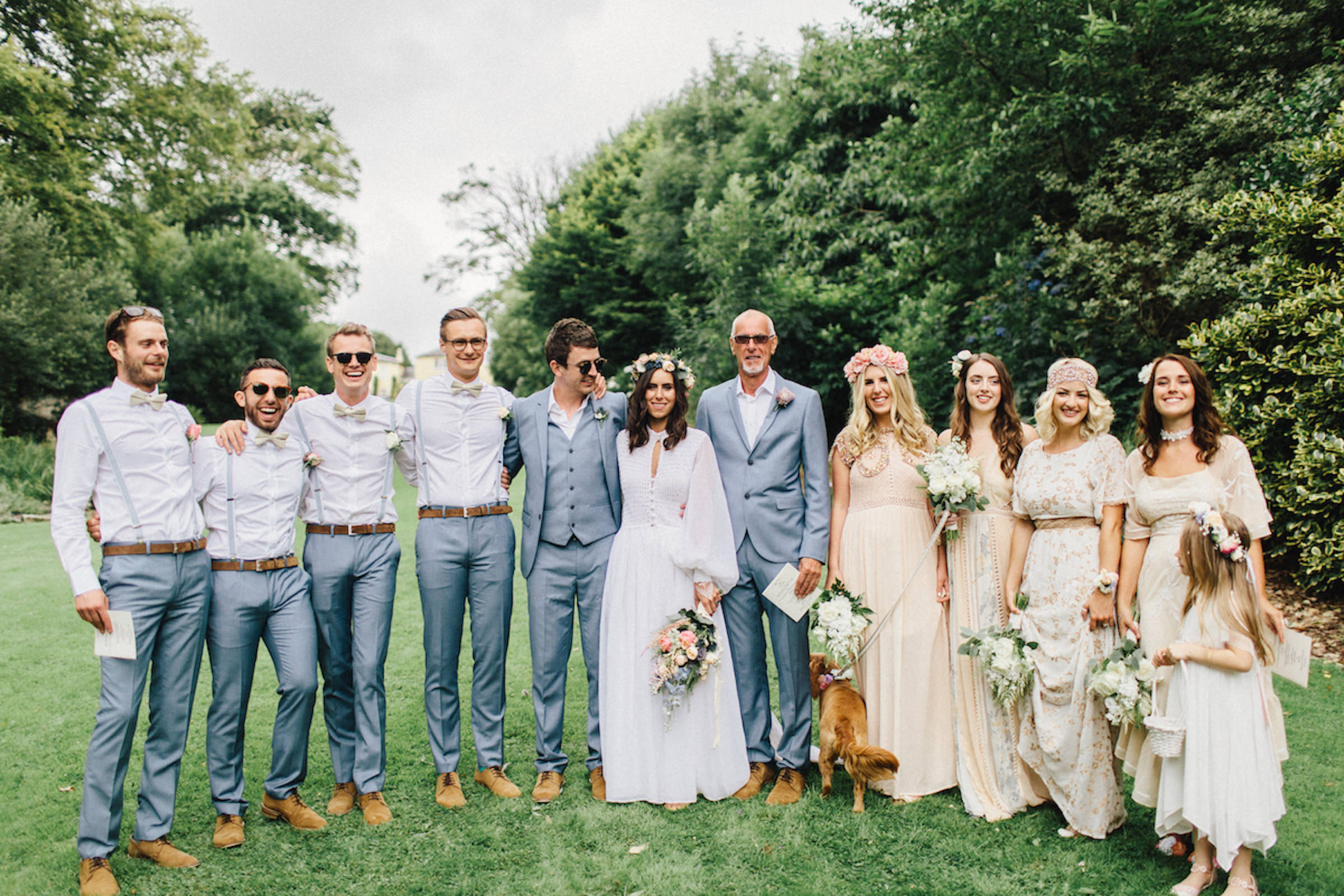 Bridal Party portraits with bride and groom, peach and denim blue colors  - photo by White Cat Studio