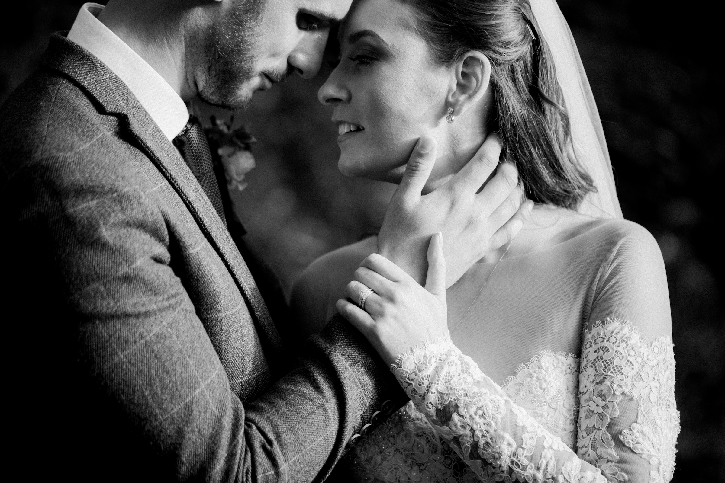 couple embracing face to face - photo by White Cat Studio