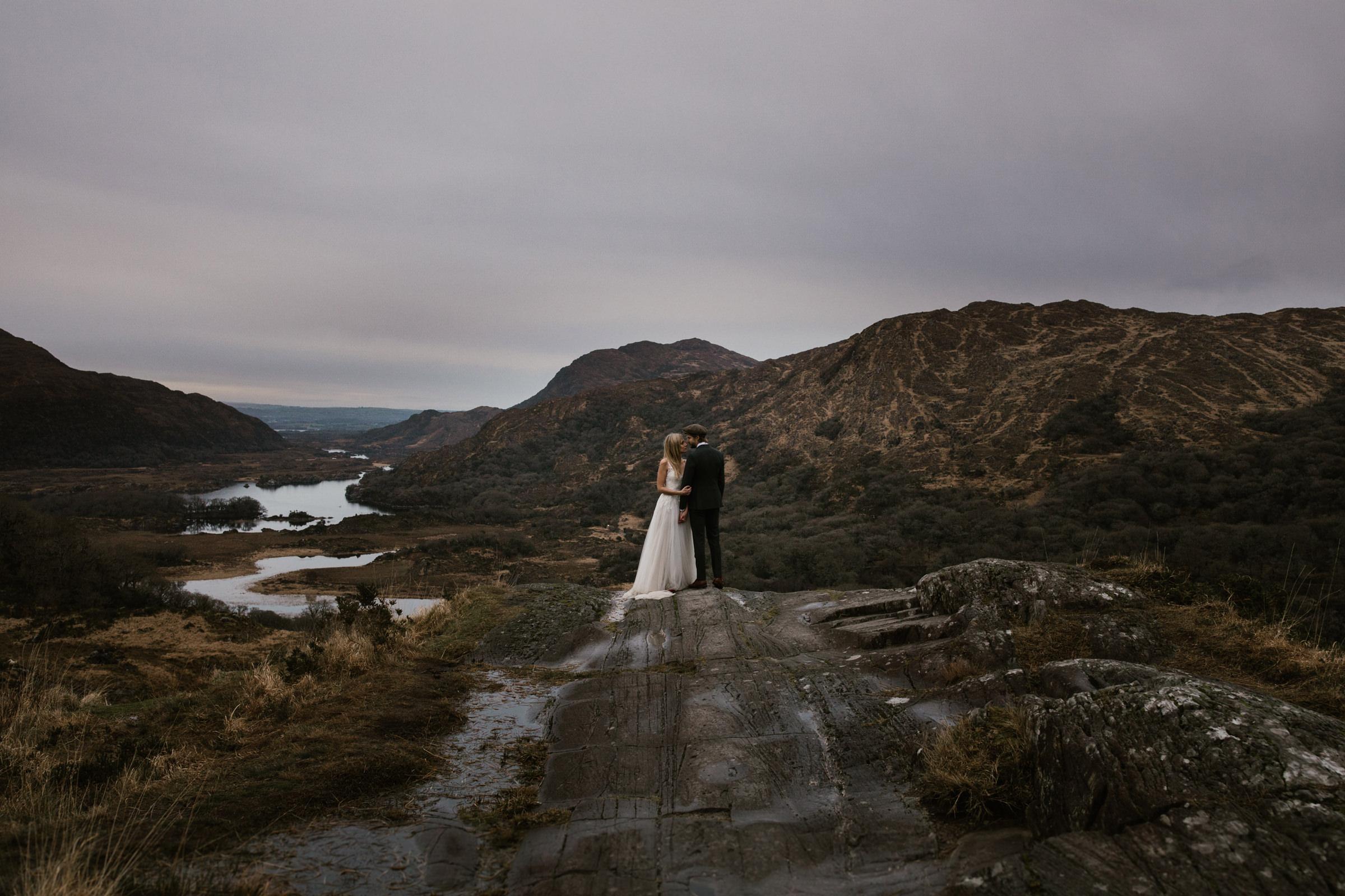 Couple in Scottish landscape - photo by White Cat Studio