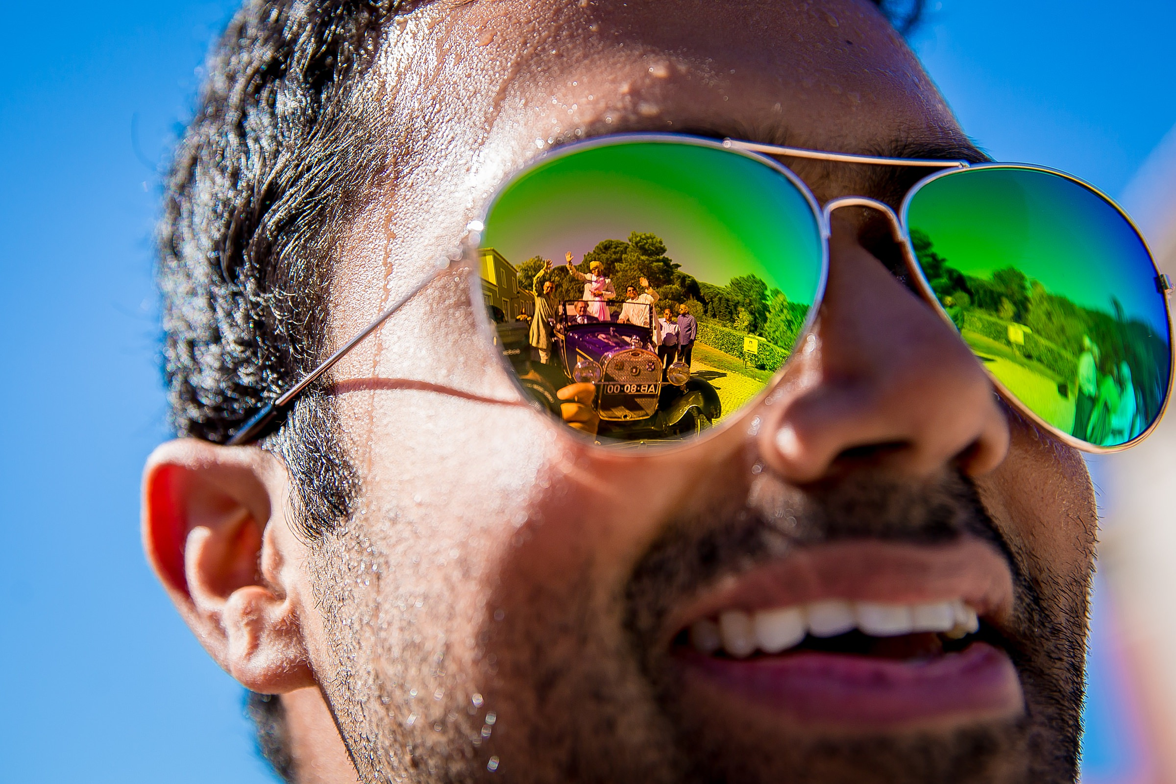 Sunglasses reflection of well wishers in vintage auto - photo by Apresh Chavda Photography