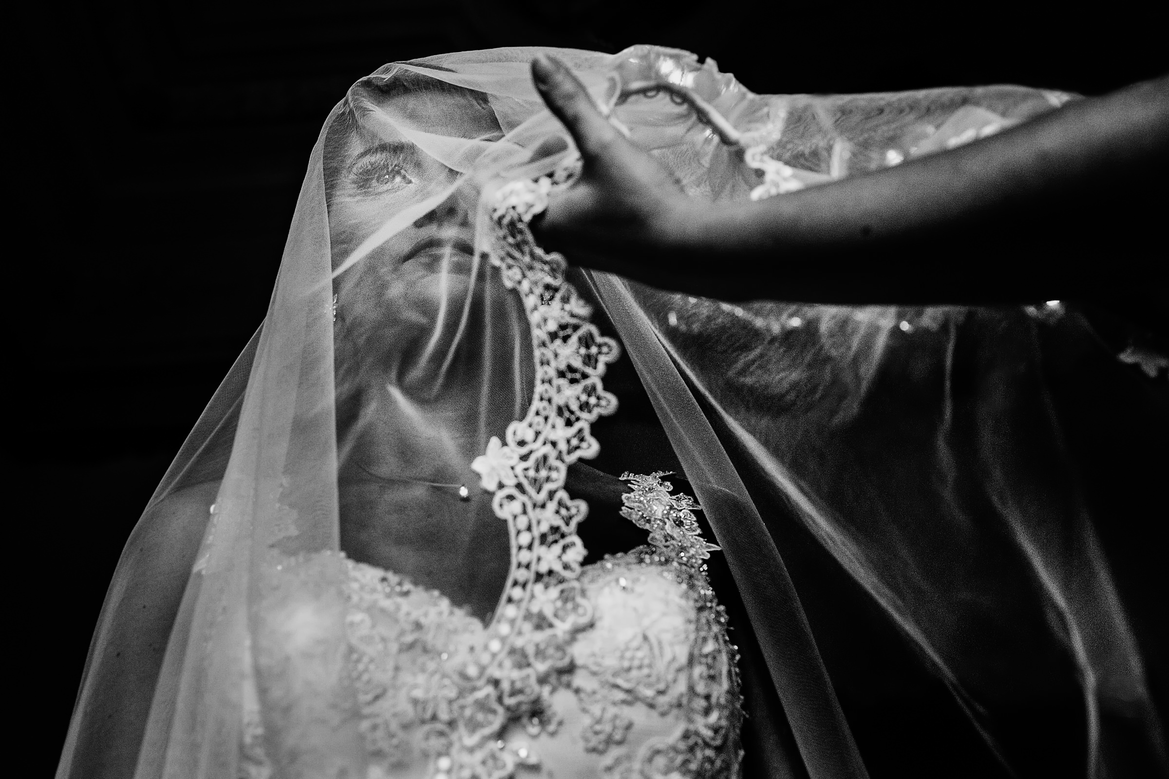 Bride being veiled - photo by D2 Photography