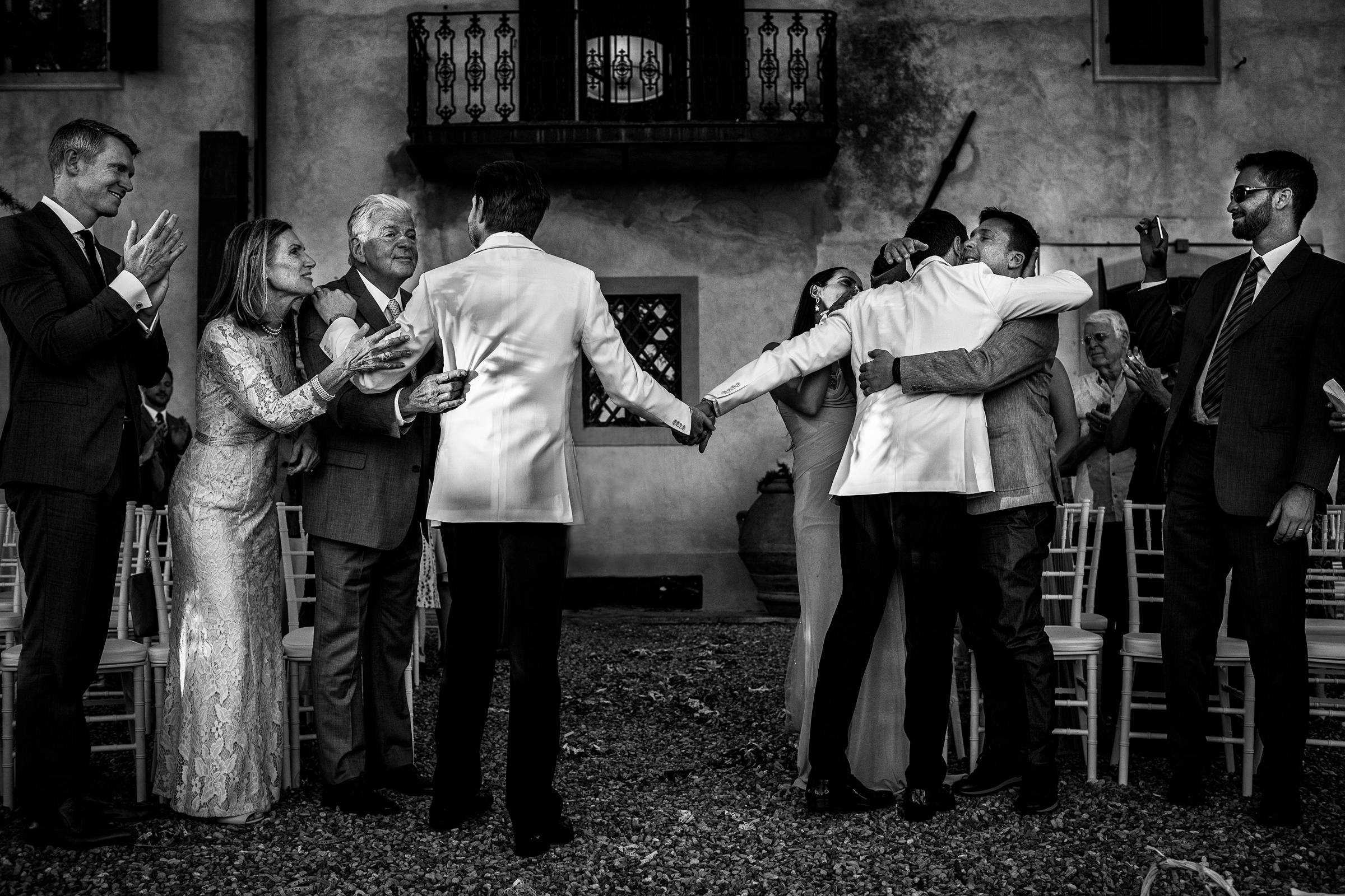 Celebratory family moment for two grooms - photo by D2 Photography