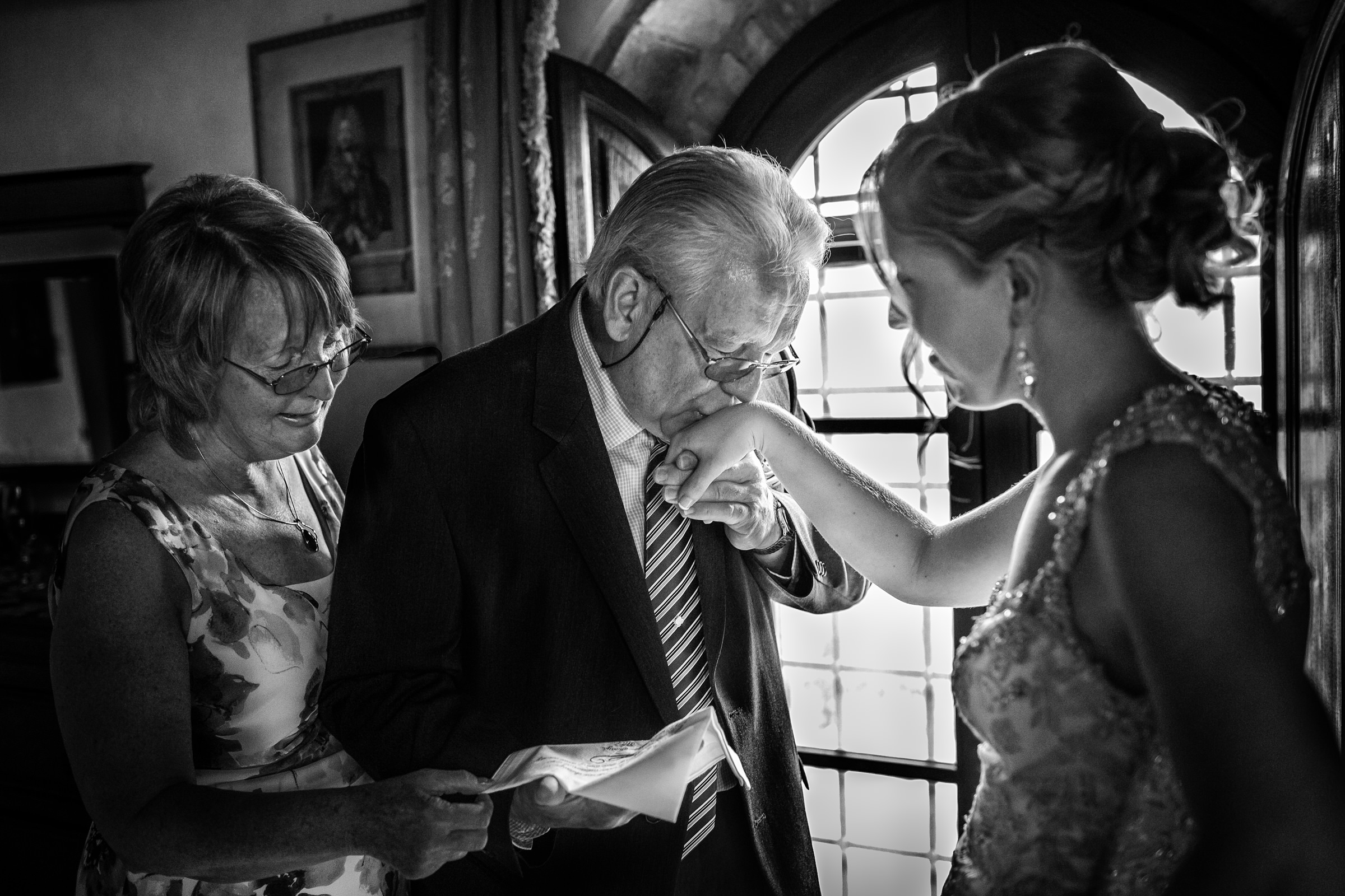 Grandfather kisses brides hand - photo by D2 Photography