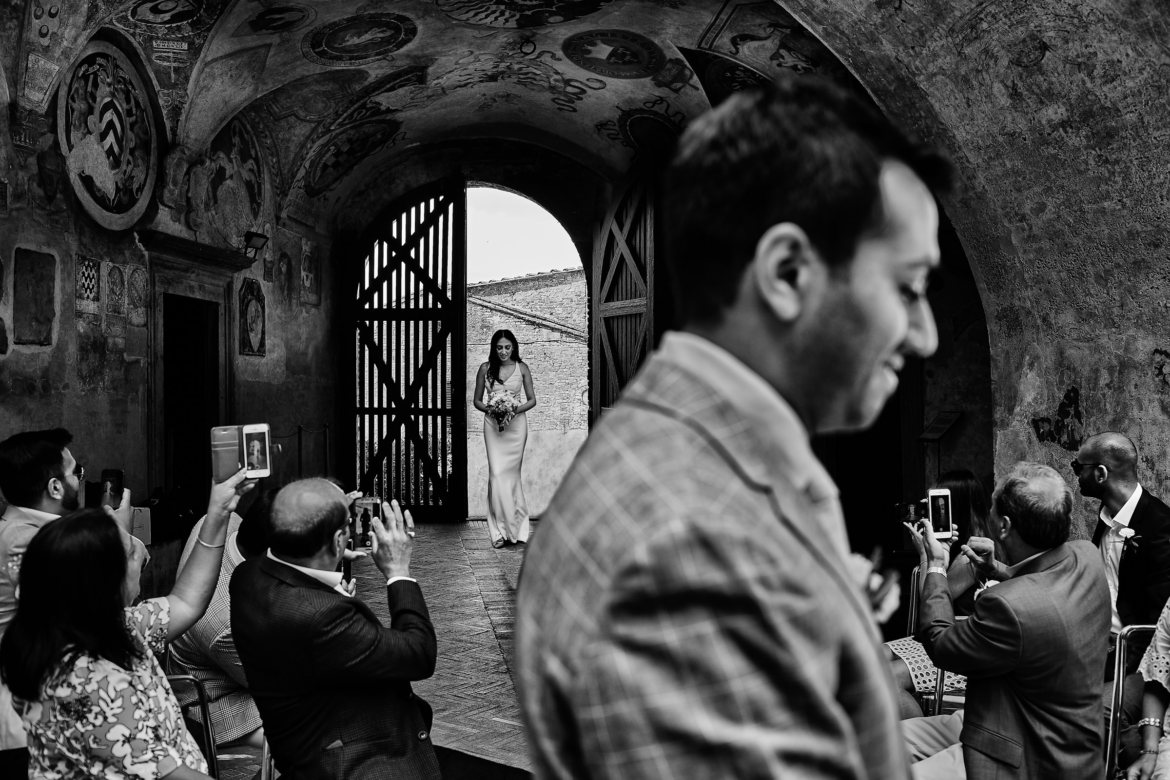 Groom awaits as bride enters - photo by D2 Photography