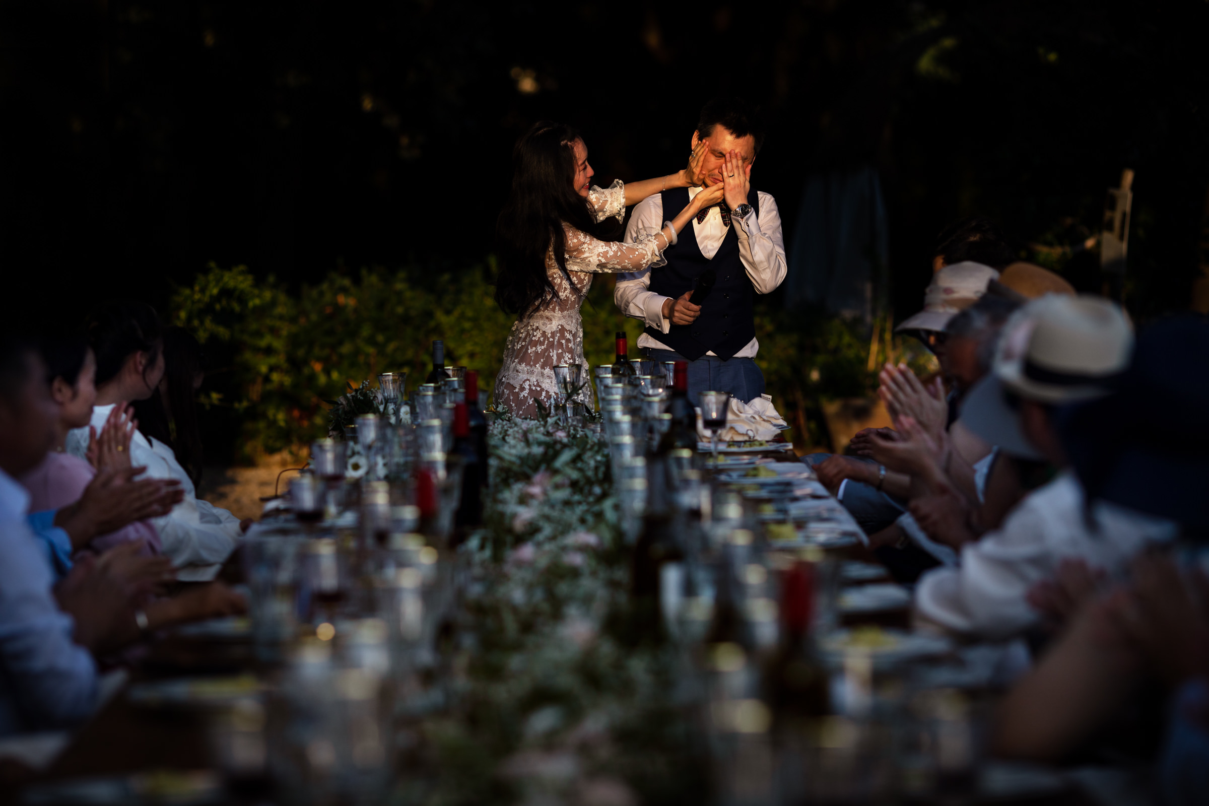 Groom cries as guests clap - photo by D2 Photography