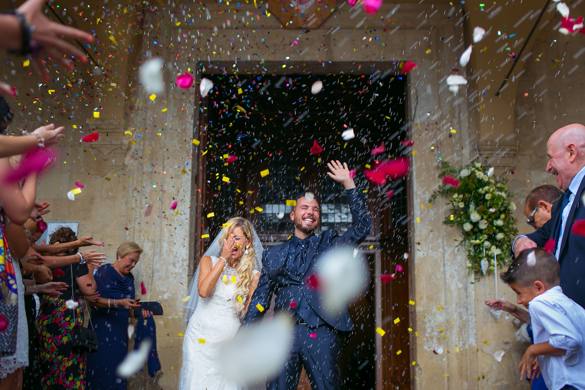Jubilant couple exit into confetti shower - photo by D2 Photography