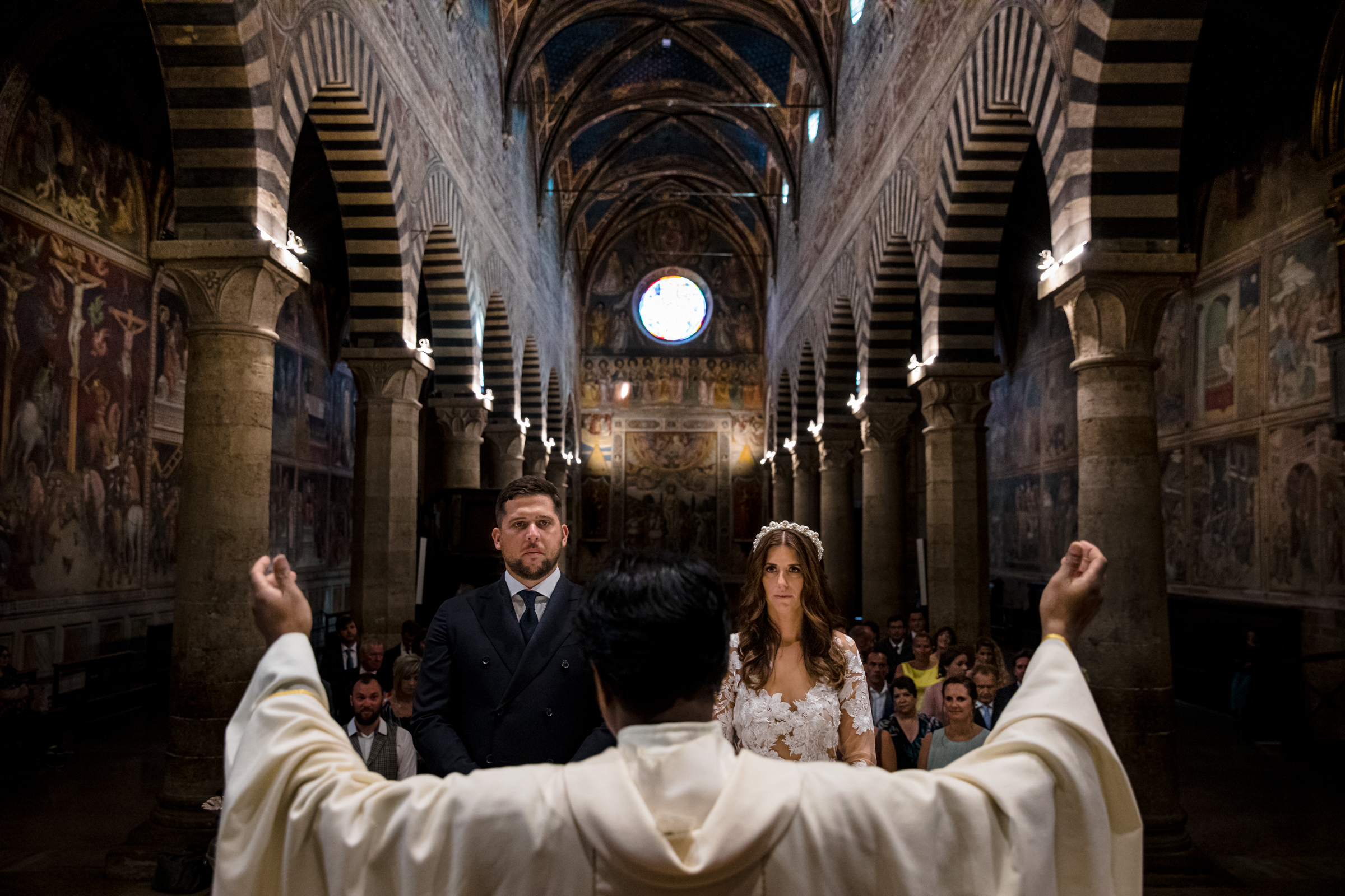 Solemn moment at church wedding ceremony - photo by D2 Photography