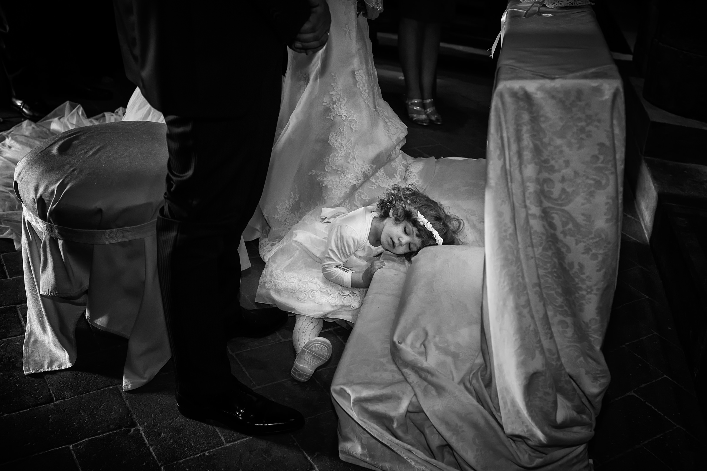 sweet flower girl napping on luxuriant fabrics - photo by D2 Photography