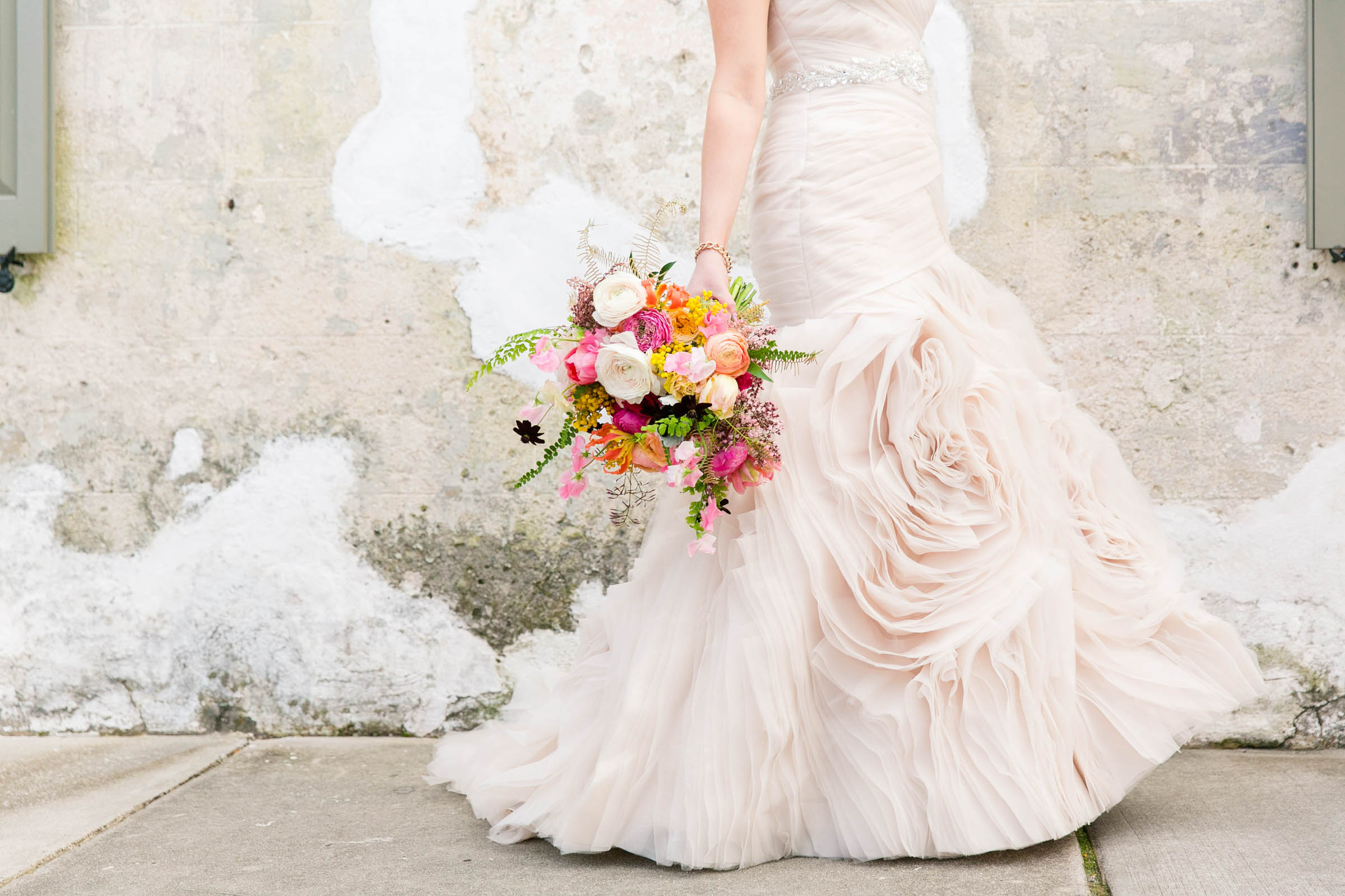 Blush bridal gown with rose shaped ruffled detail  - photo by Dana Cubbage Weddings