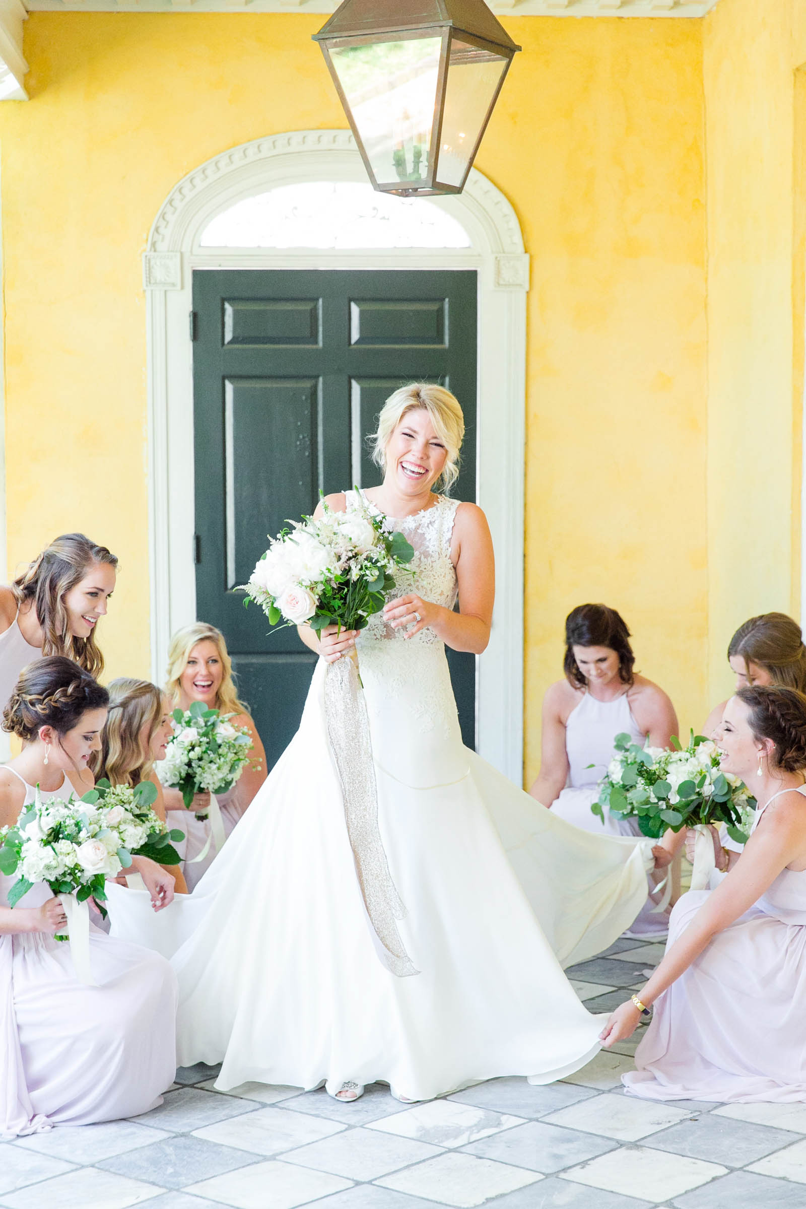 Bridal gown arranged by bridesmaids - photo by Dana Cubbage Weddings