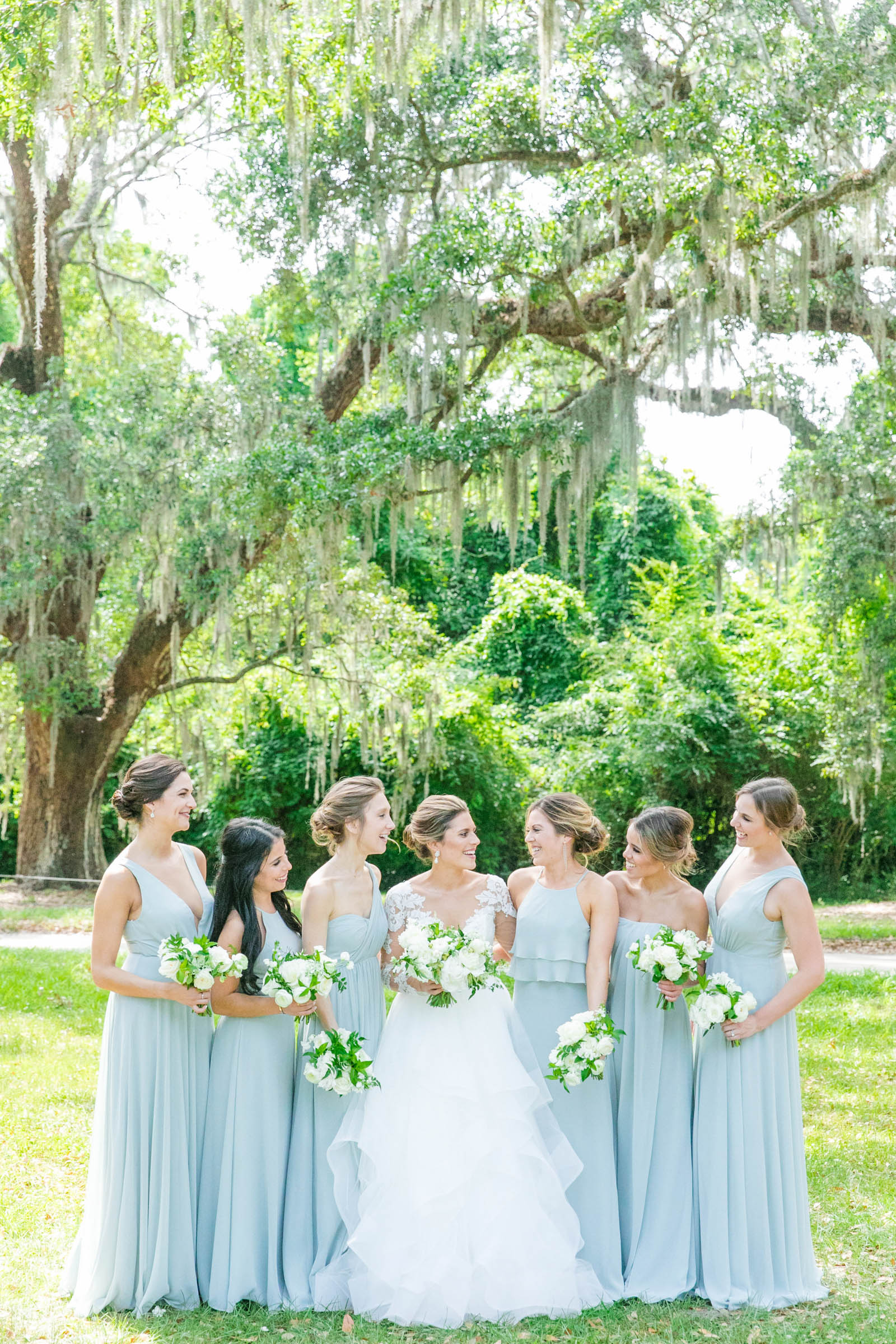 Bride and bridal party portrait under spanish moss - photo by Dana Cubbage Weddings