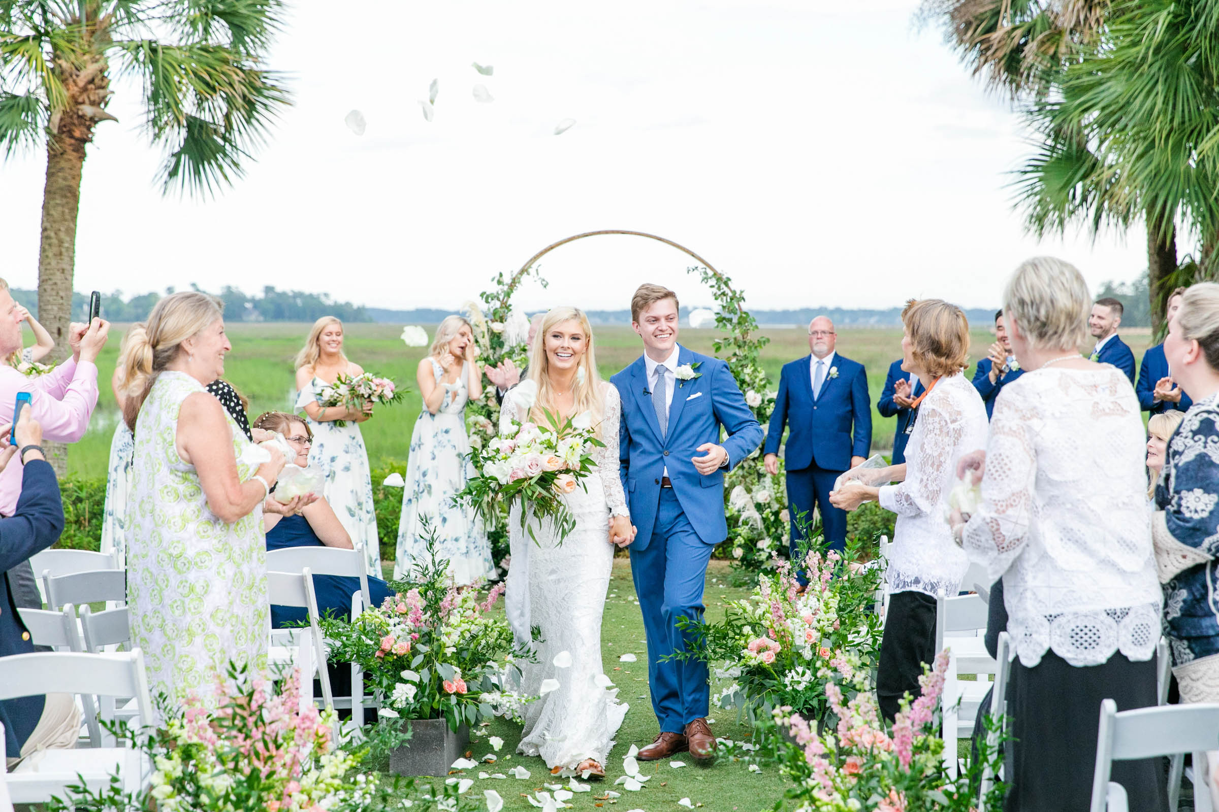 Bride and groom outdoor recessional among the flowers - photo by Dana Cubbage Weddings