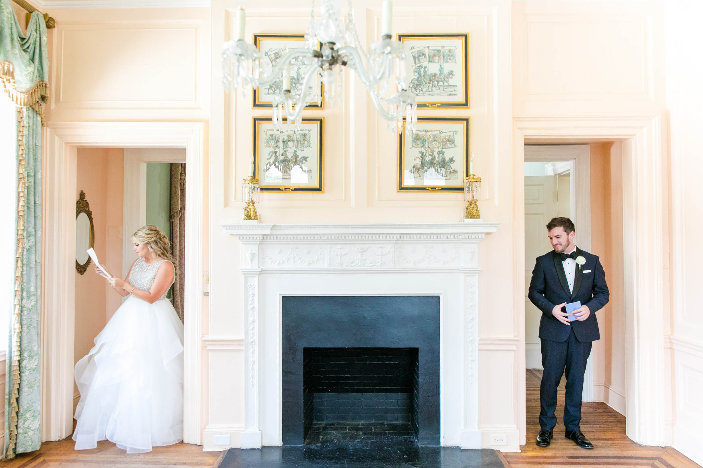 Bride and groom reading on either side of fireplace - photo by Dana Cubbage Weddings