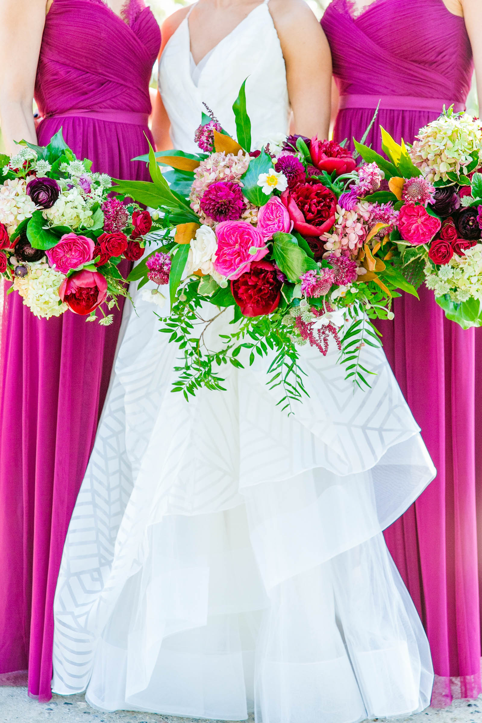 Bride with bridesmaids in fuschia and bright bouquets - photo by Dana Cubbage Weddings