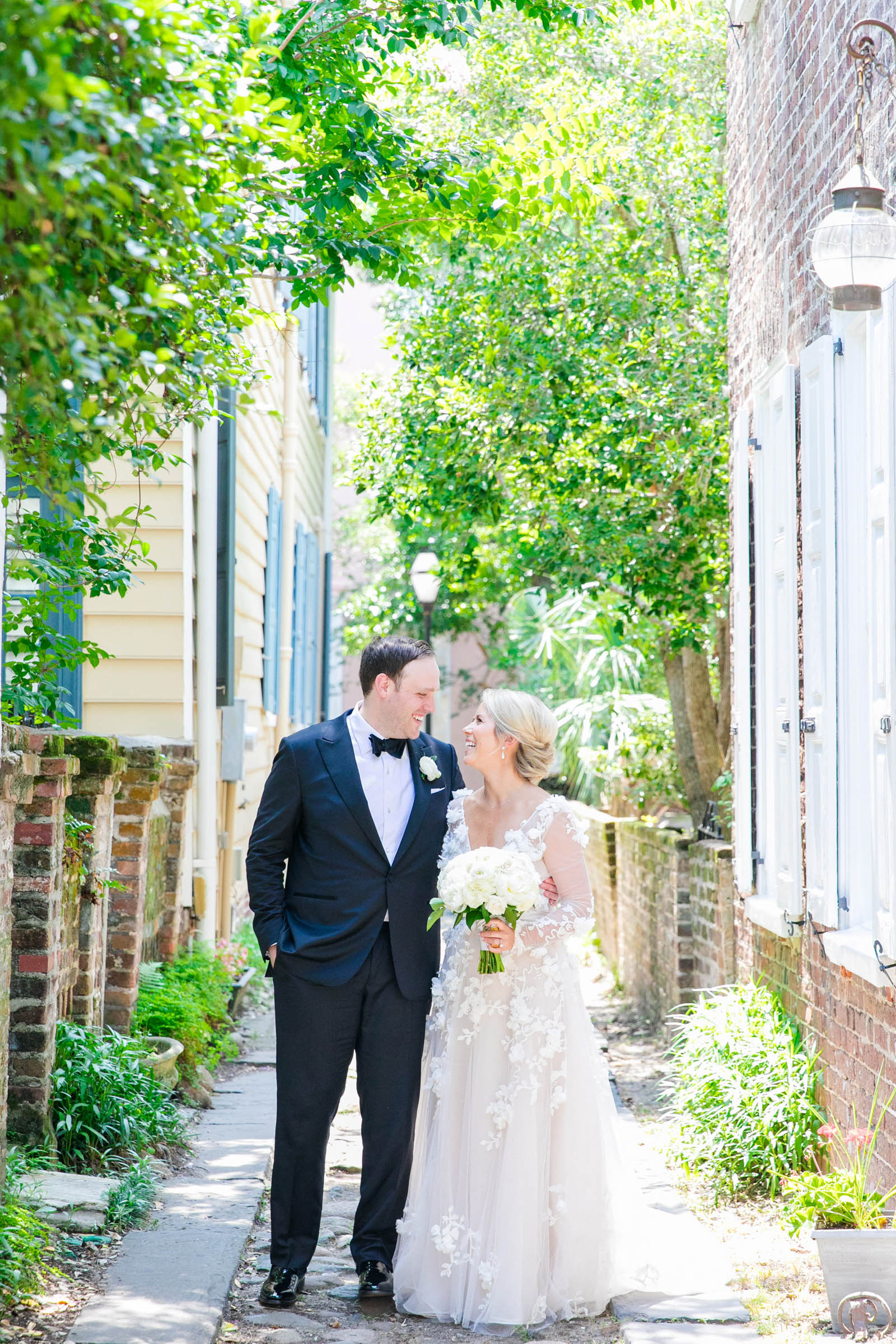 Couple in picturesque alley- photo by Dana Cubbage Weddings