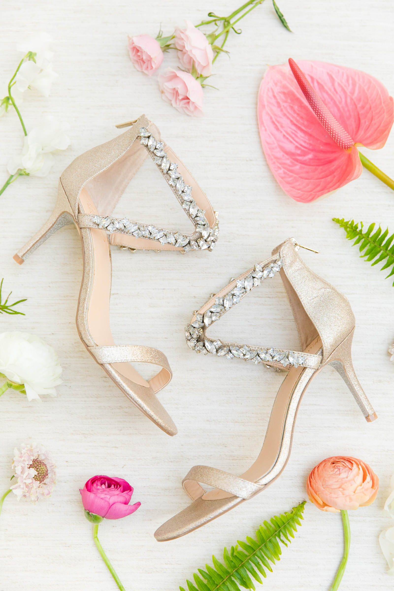 Flat lay with jeweled bridal shoes - photo by Dana Cubbage Weddings