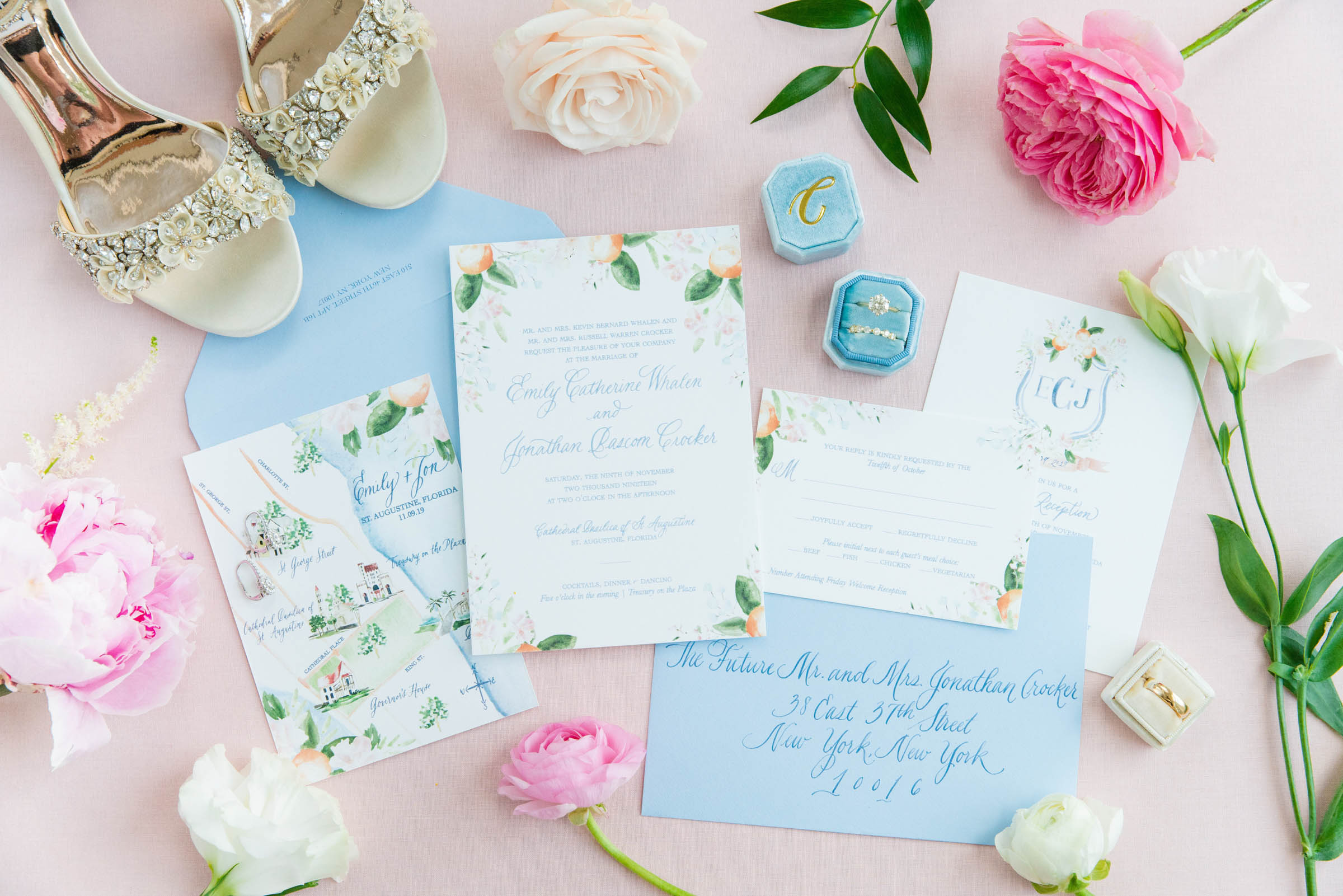 Flatlay with rings stationery and bridal shoes - photo by Dana Cubbage Weddings